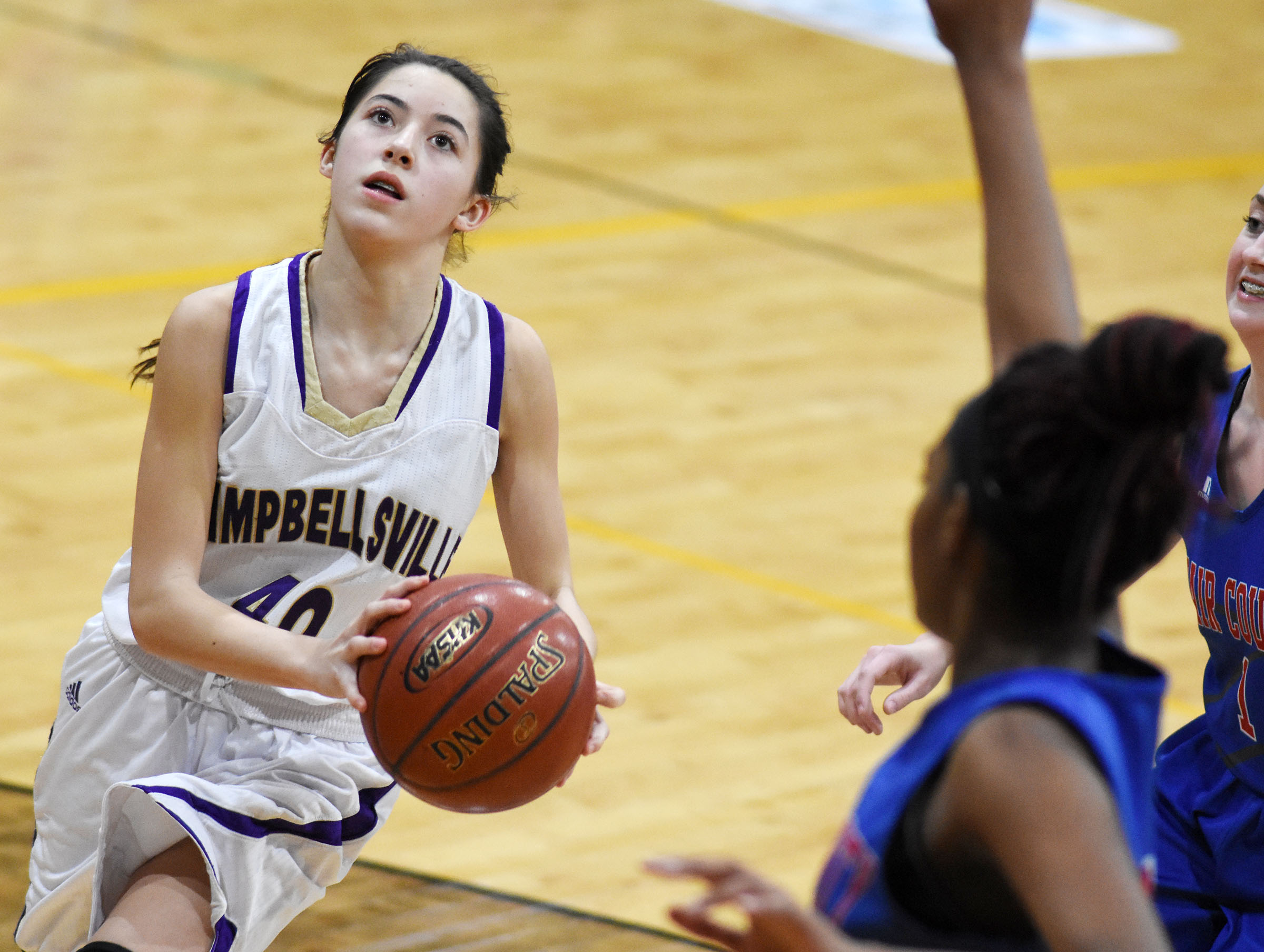 Campbellsville Middle School eighth-grader Kaylyn Smith shoots.