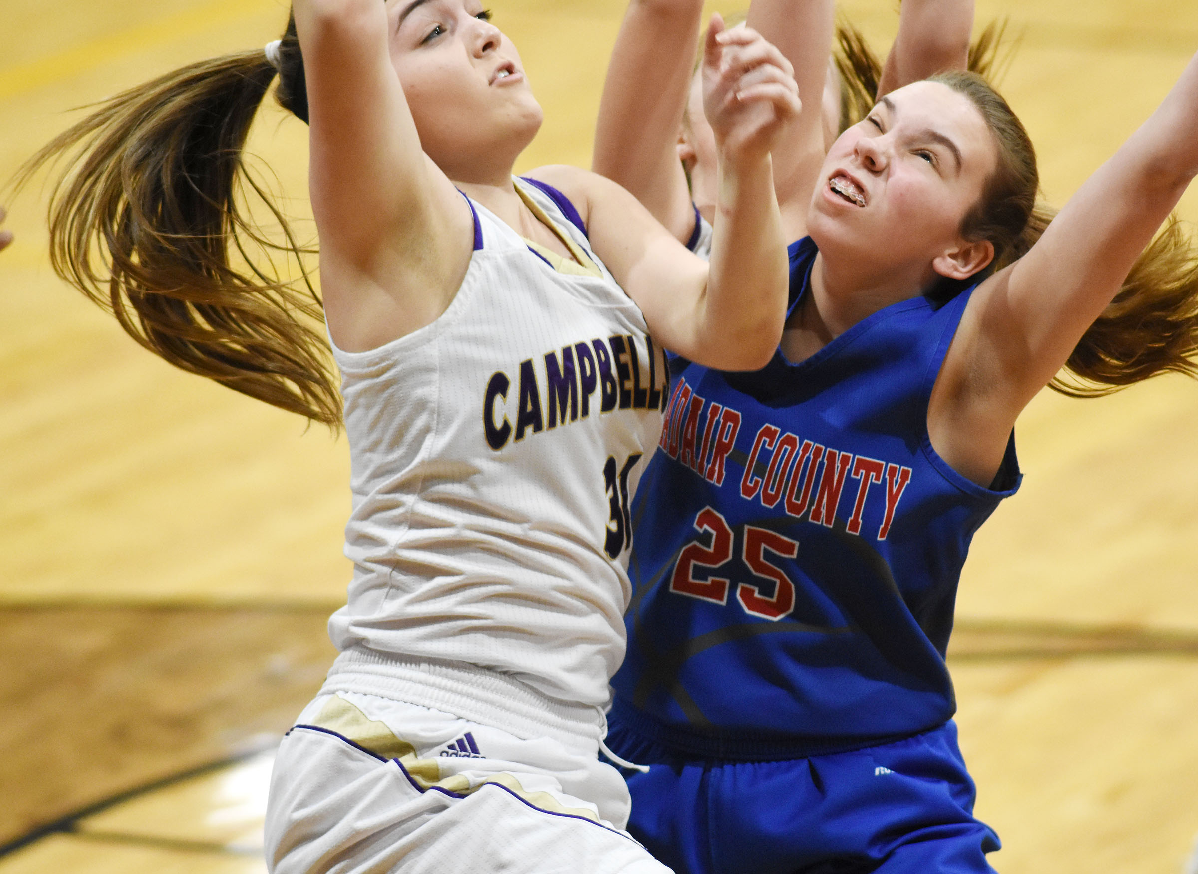 CHS freshman Kenzi Forbis fights for a rebound.