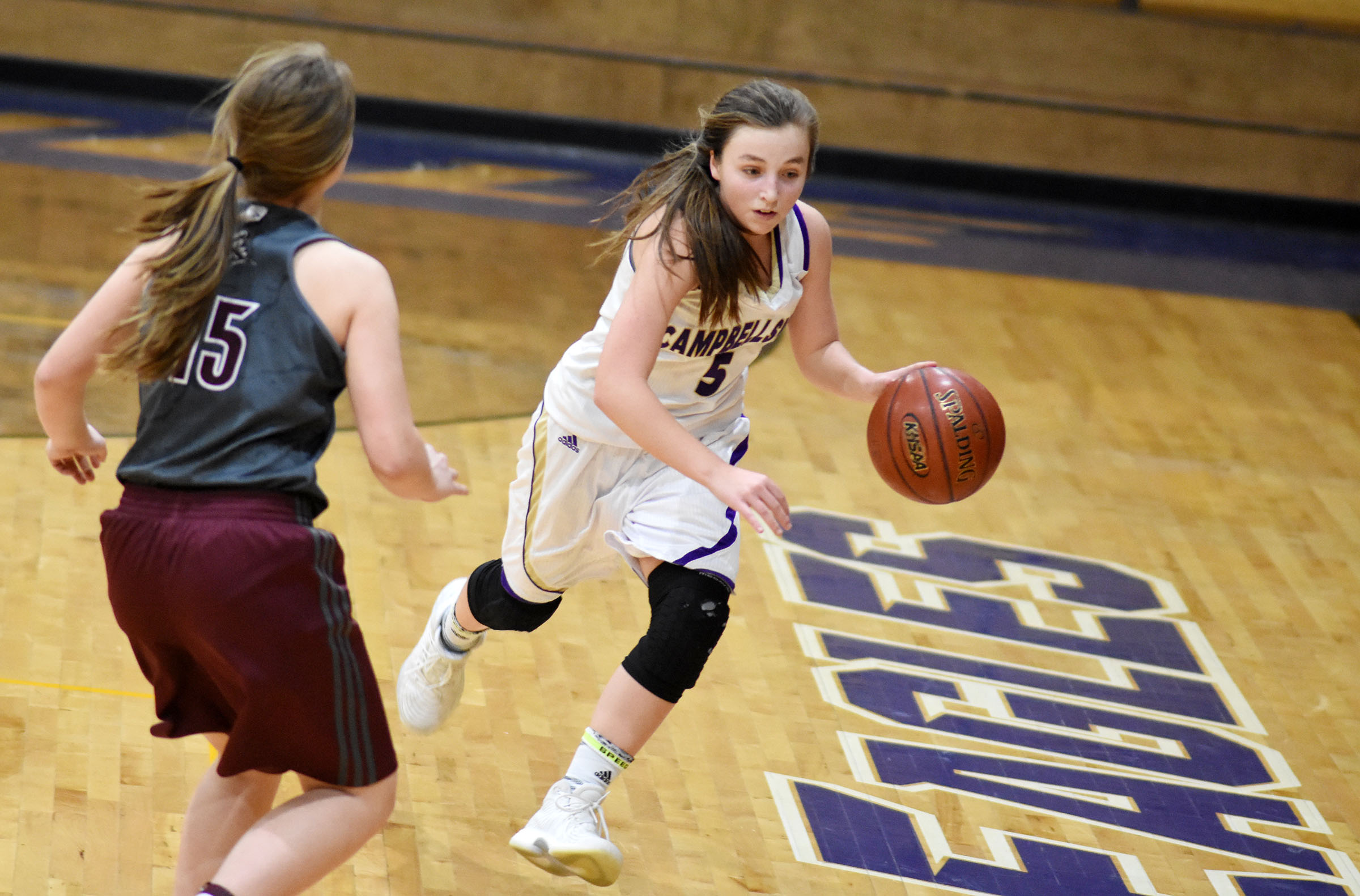 Campbellsville Middle School eighth-grader Lainey Watson dribbles to the basket.