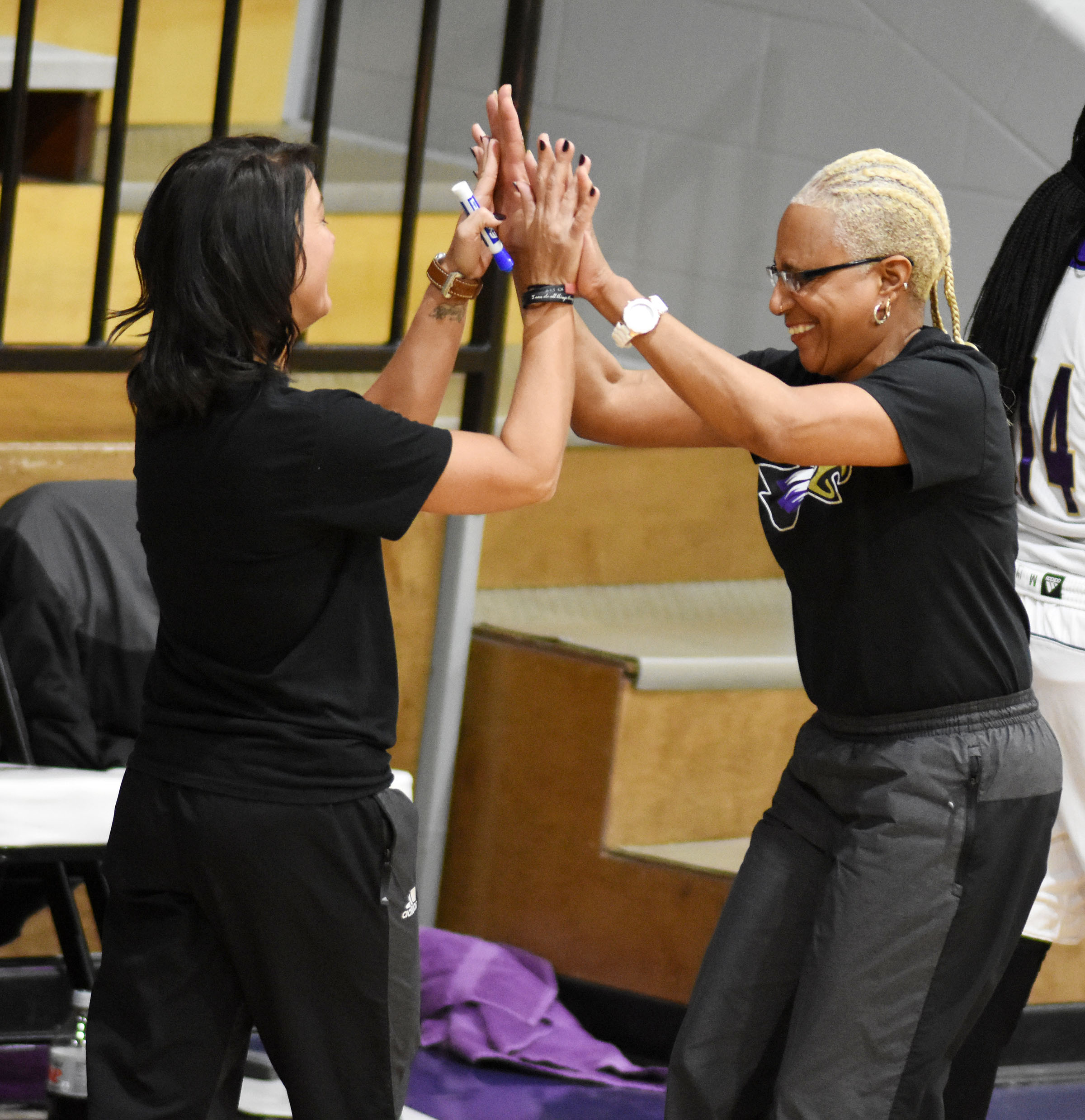 CHS girls' basketball assistant coaches Natalia Warren, at left, and Debbie Gowdy-Smith celebrate after their players win the 20th District tournament.