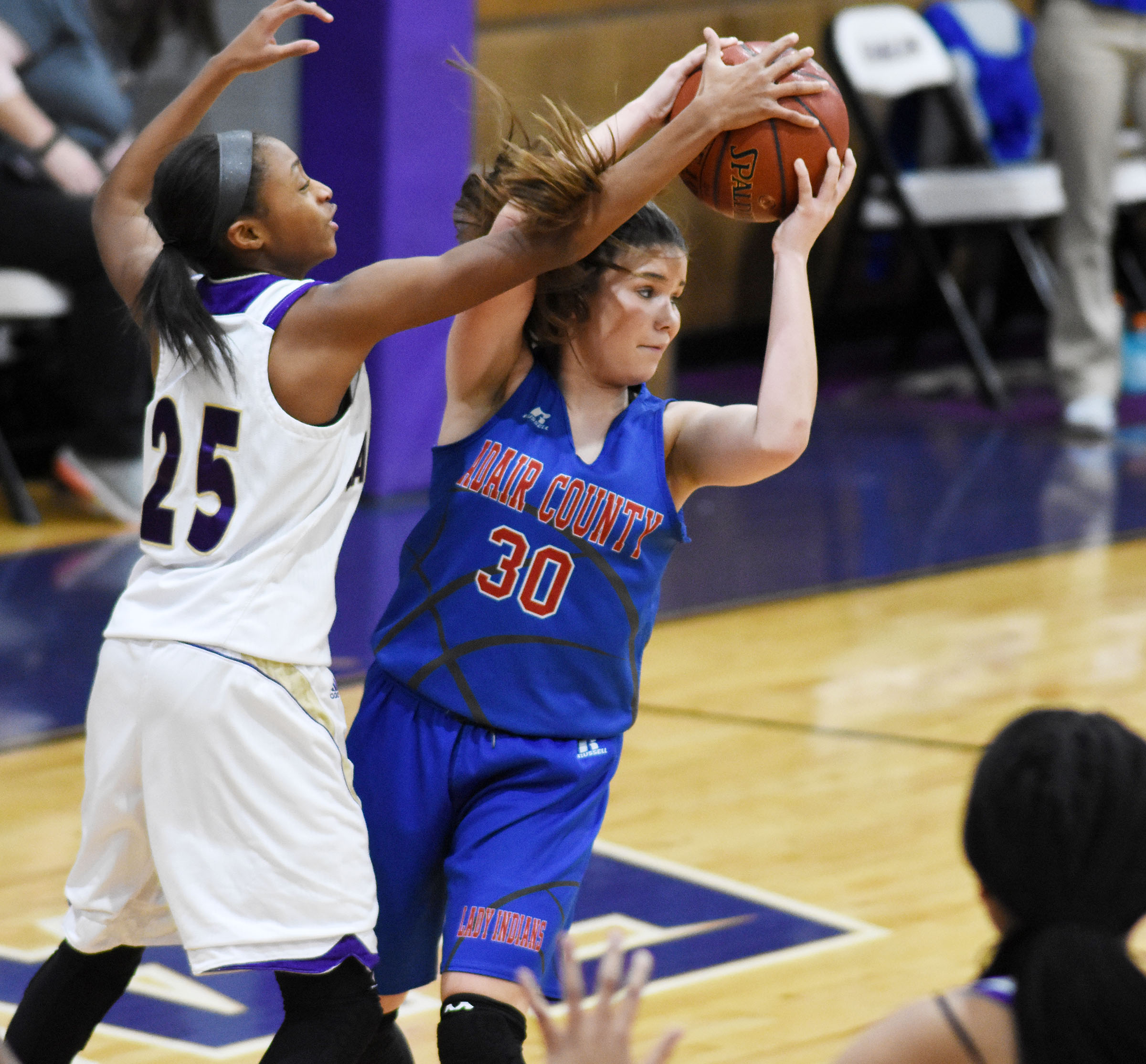 Campbellsville Middle School eighth-grader Bri Gowdy fights for the ball.