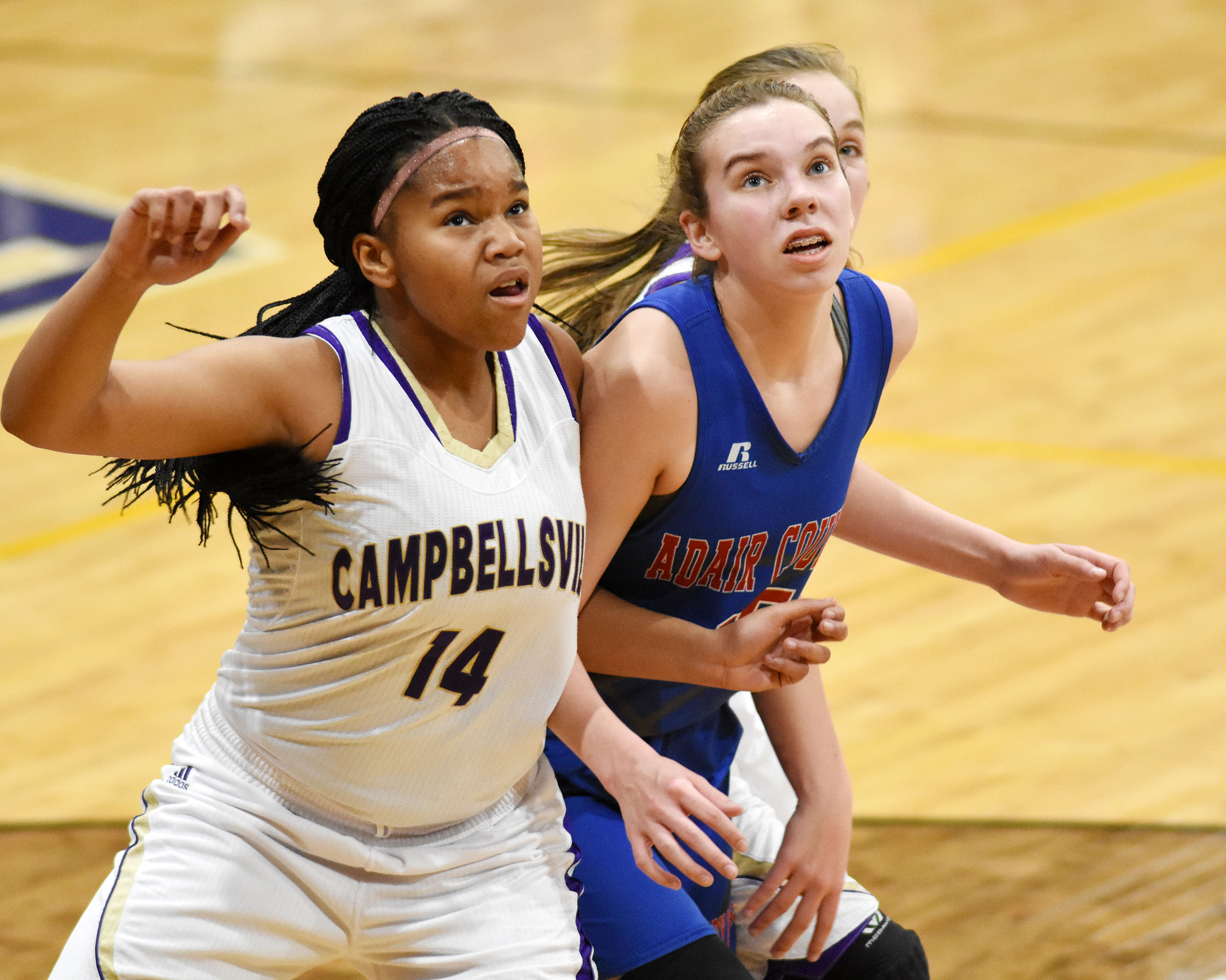 Campbellsville Middle School seventh-grader Antaya Epps looks for a rebound.