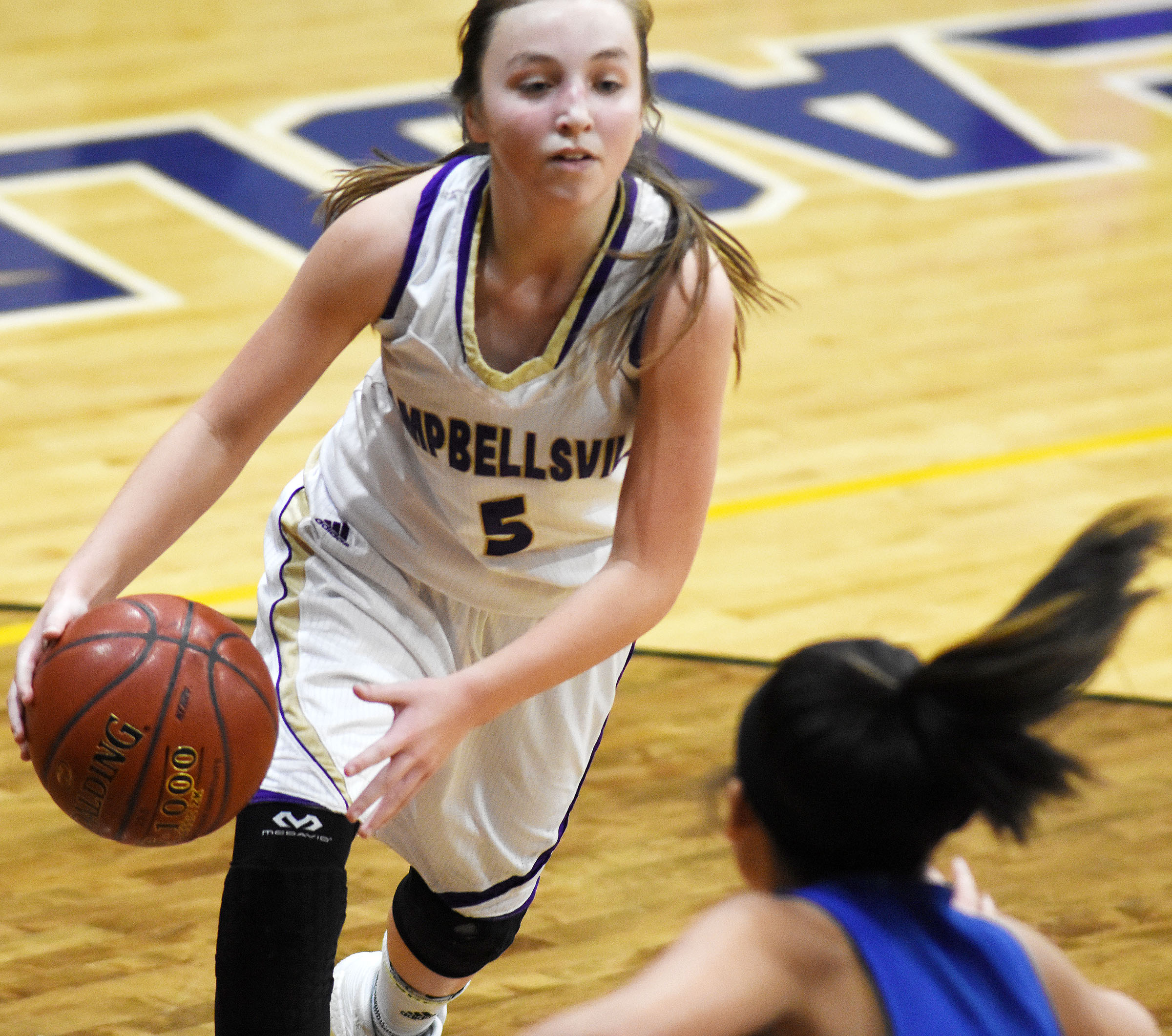 Campbellsville Middle School eighth-grader Lainey Watson drives the ball.