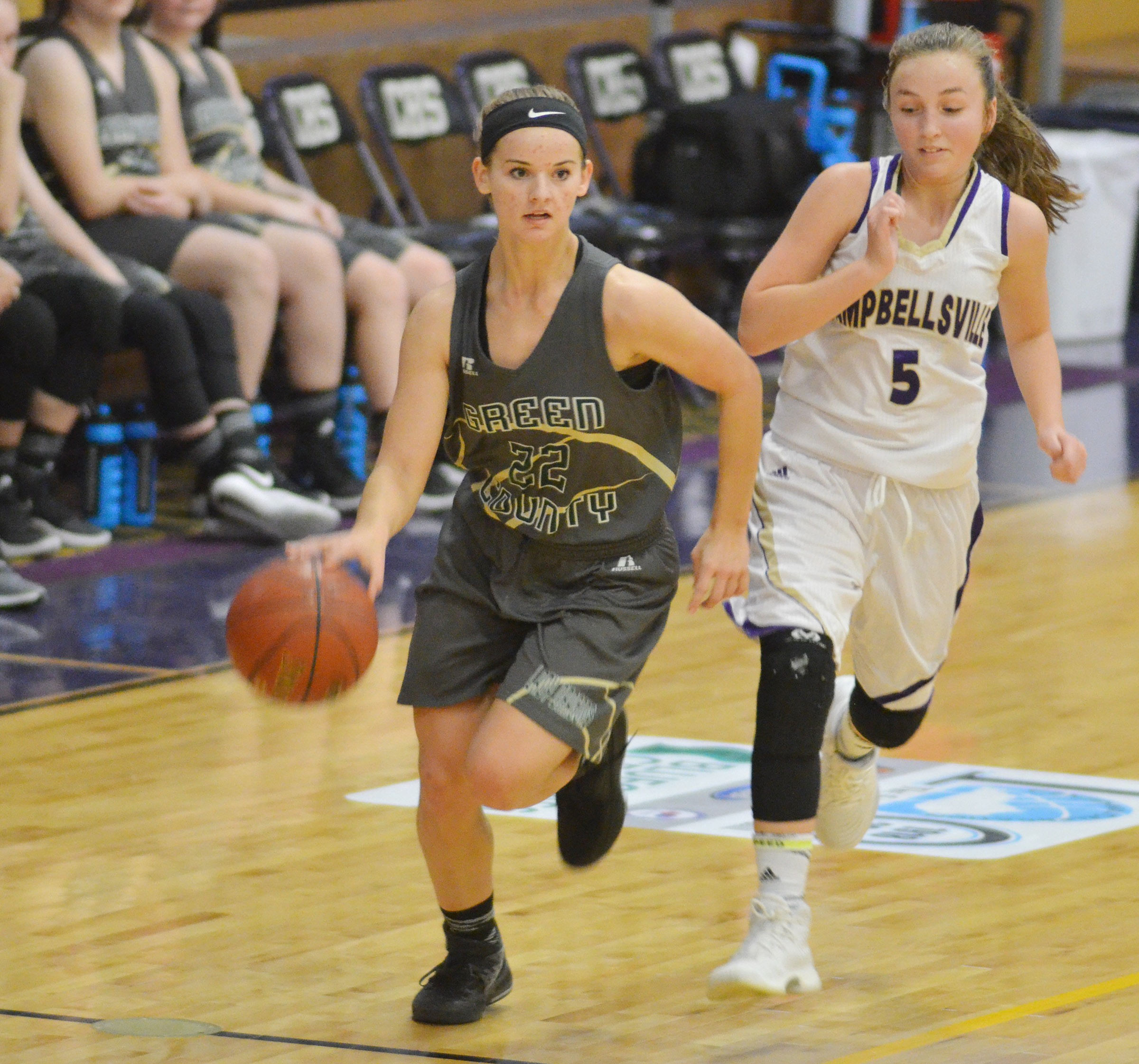 Campbellsville Middle School eighth-grader Lainey Watson runs down the court.