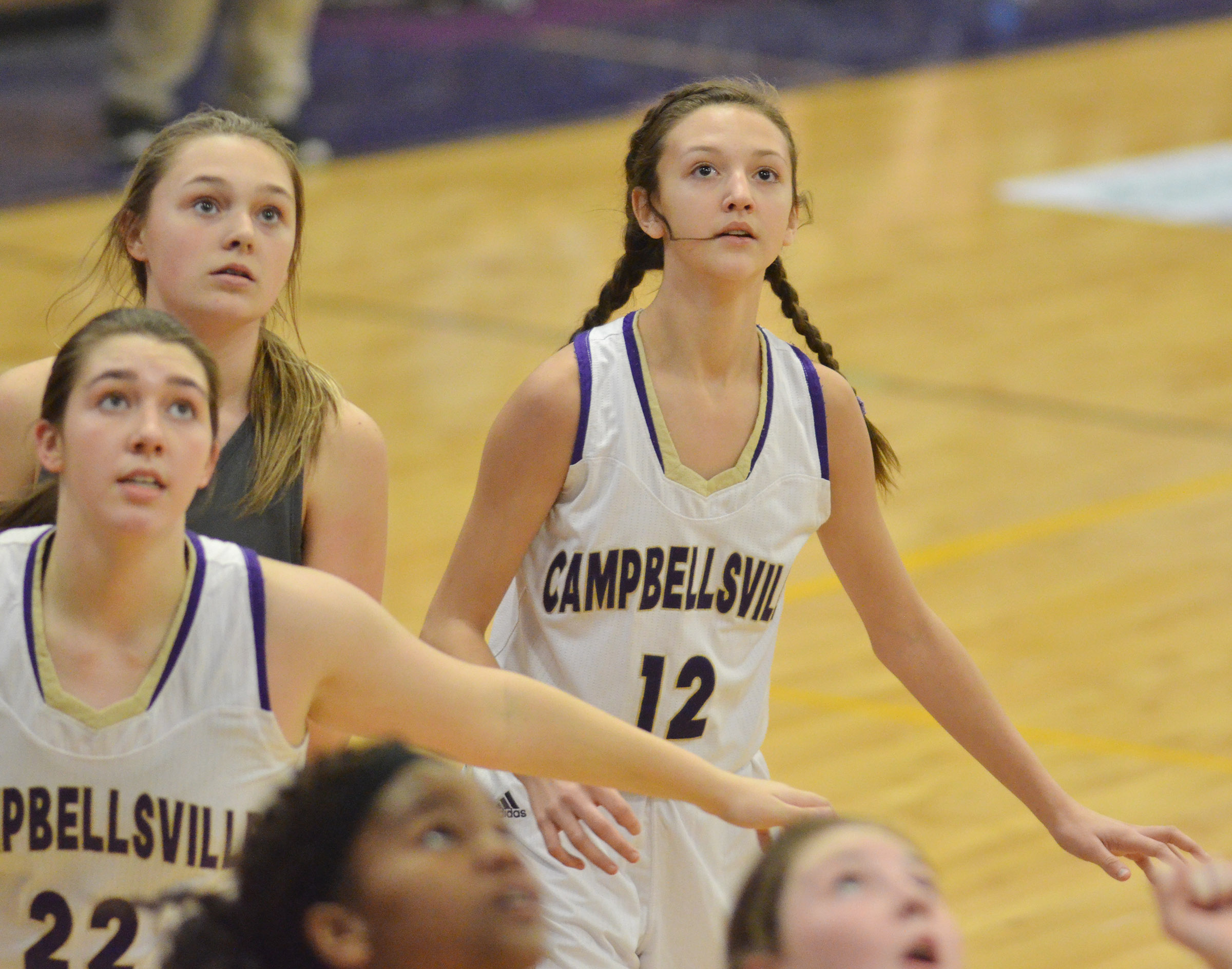 Campbellsville Middle School seventh-grader Bri Hayes looks for a rebound.