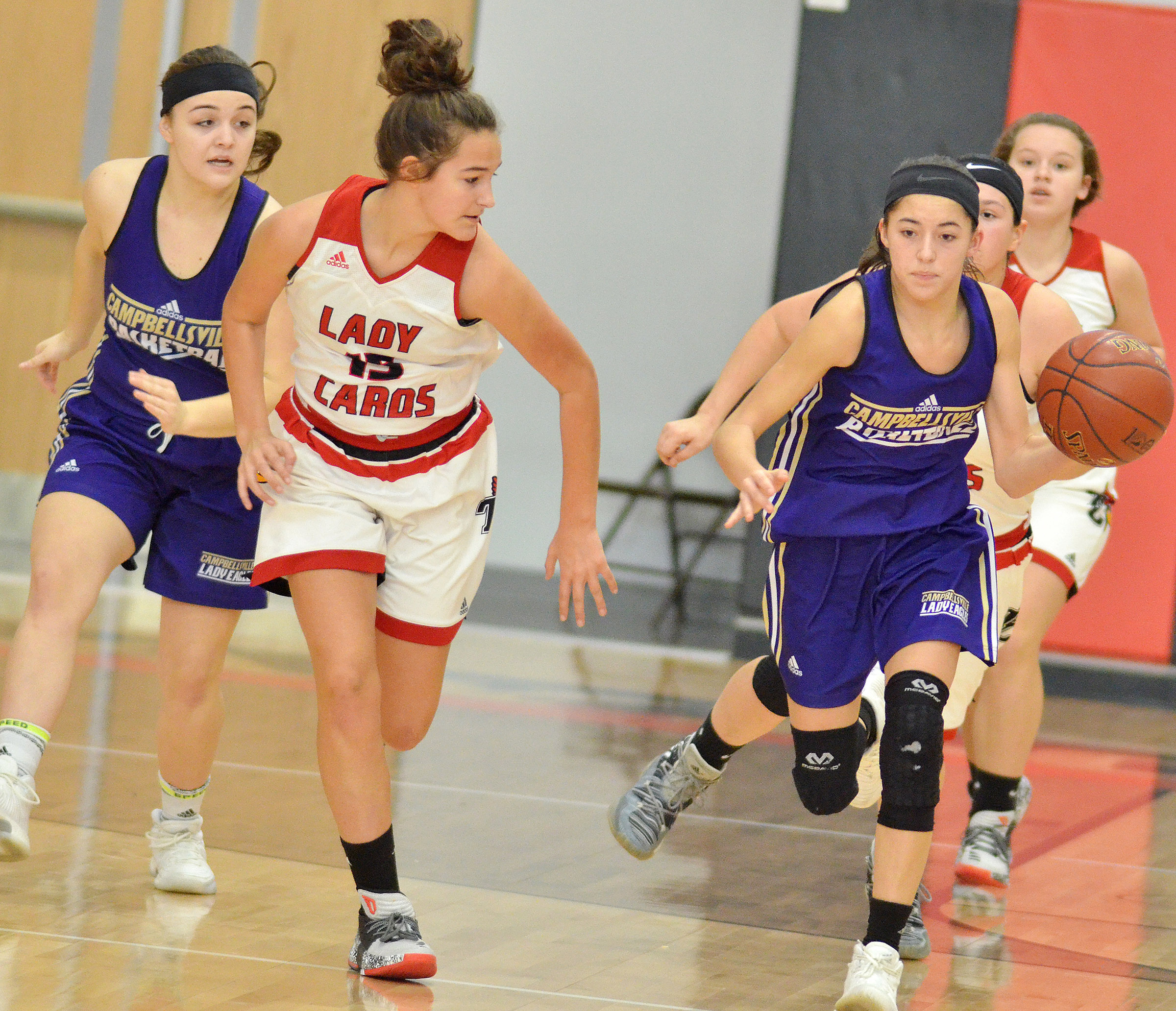 Campbellsville Middle School eighth-grader Kaylyn Smith drives the ball.