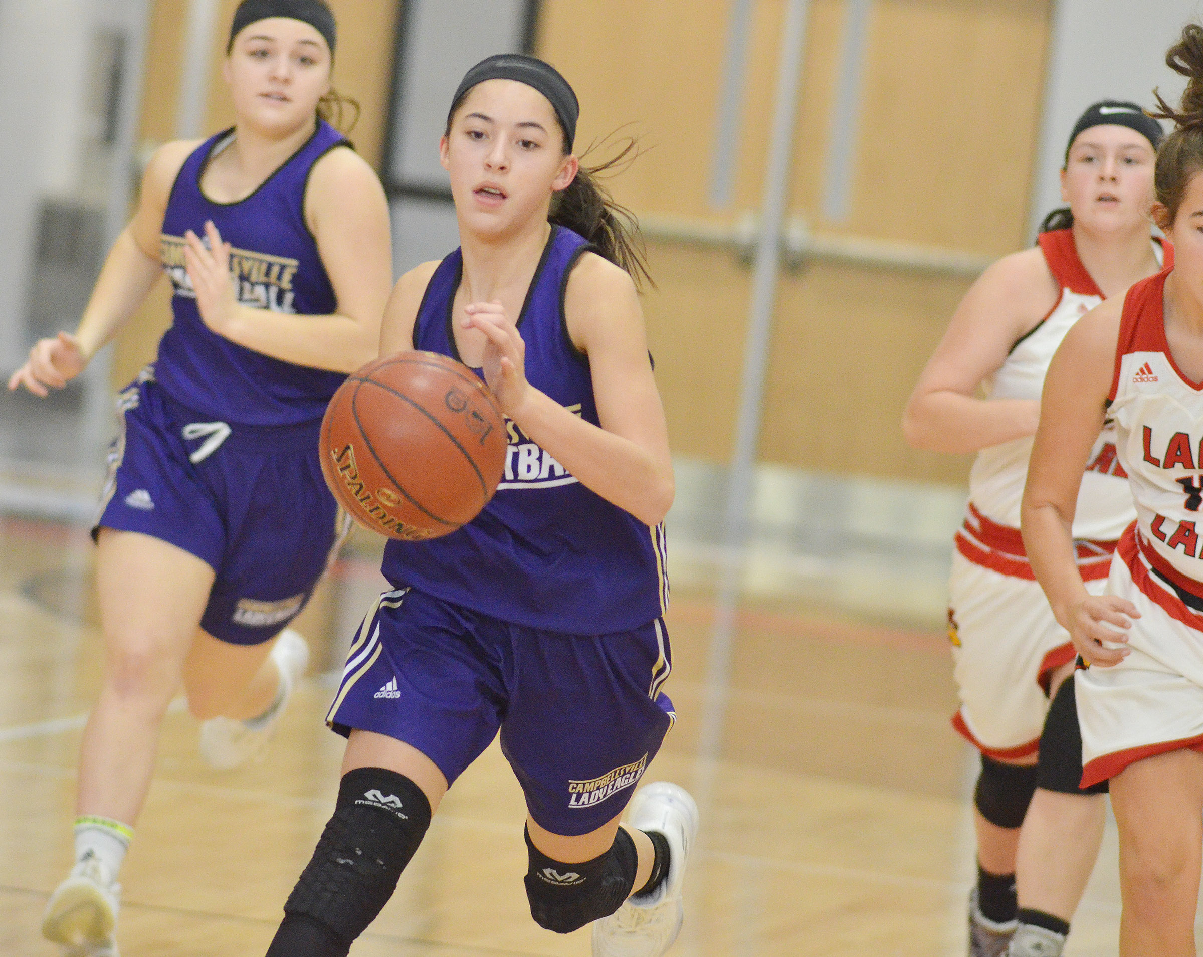 Campbellsville Middle School eighth-grader Kaylyn Smith dribbles to the hoop.