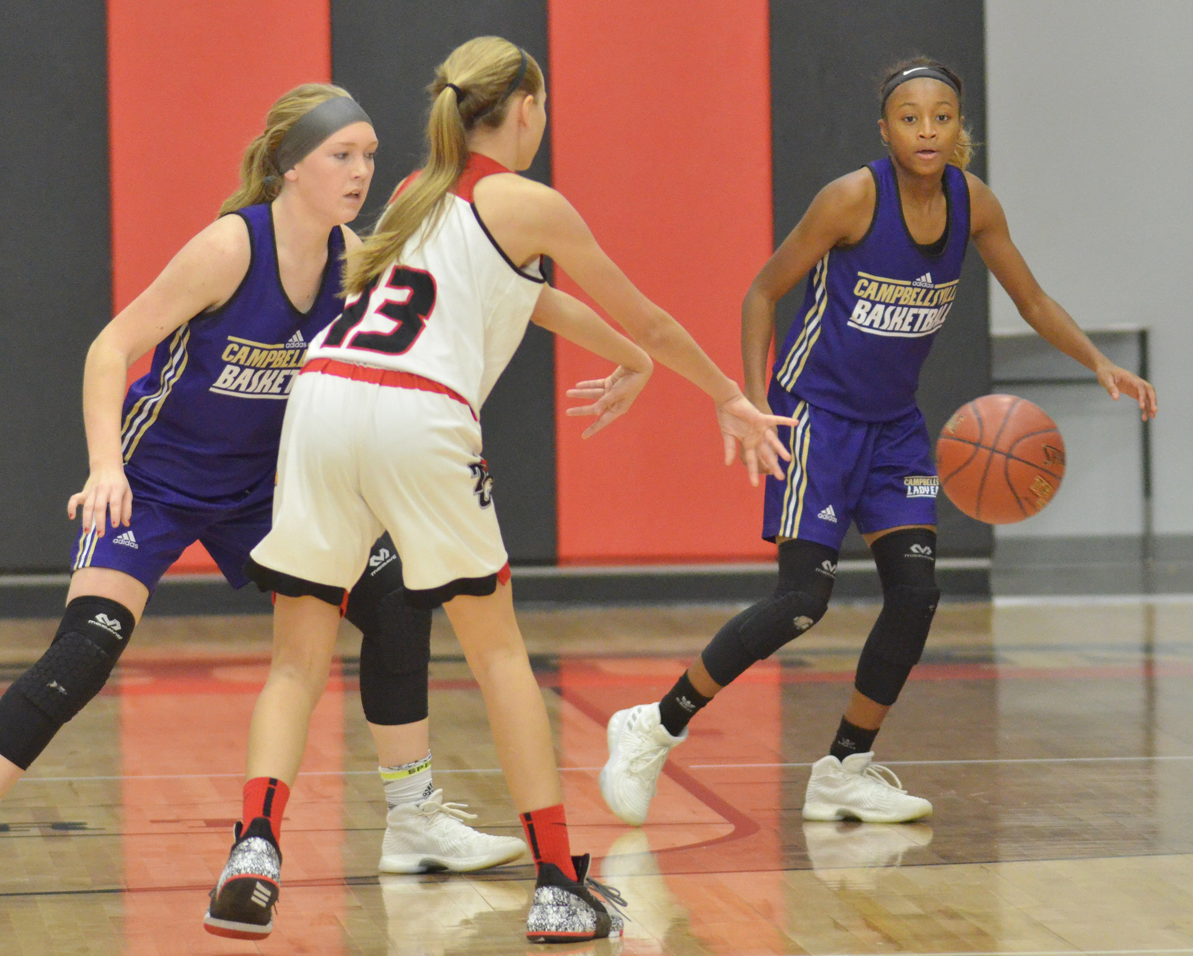CHS freshman Catlyn Clausen, at left, and Campbellsville Middle School eighth-grader Bri Gowdy play defense.