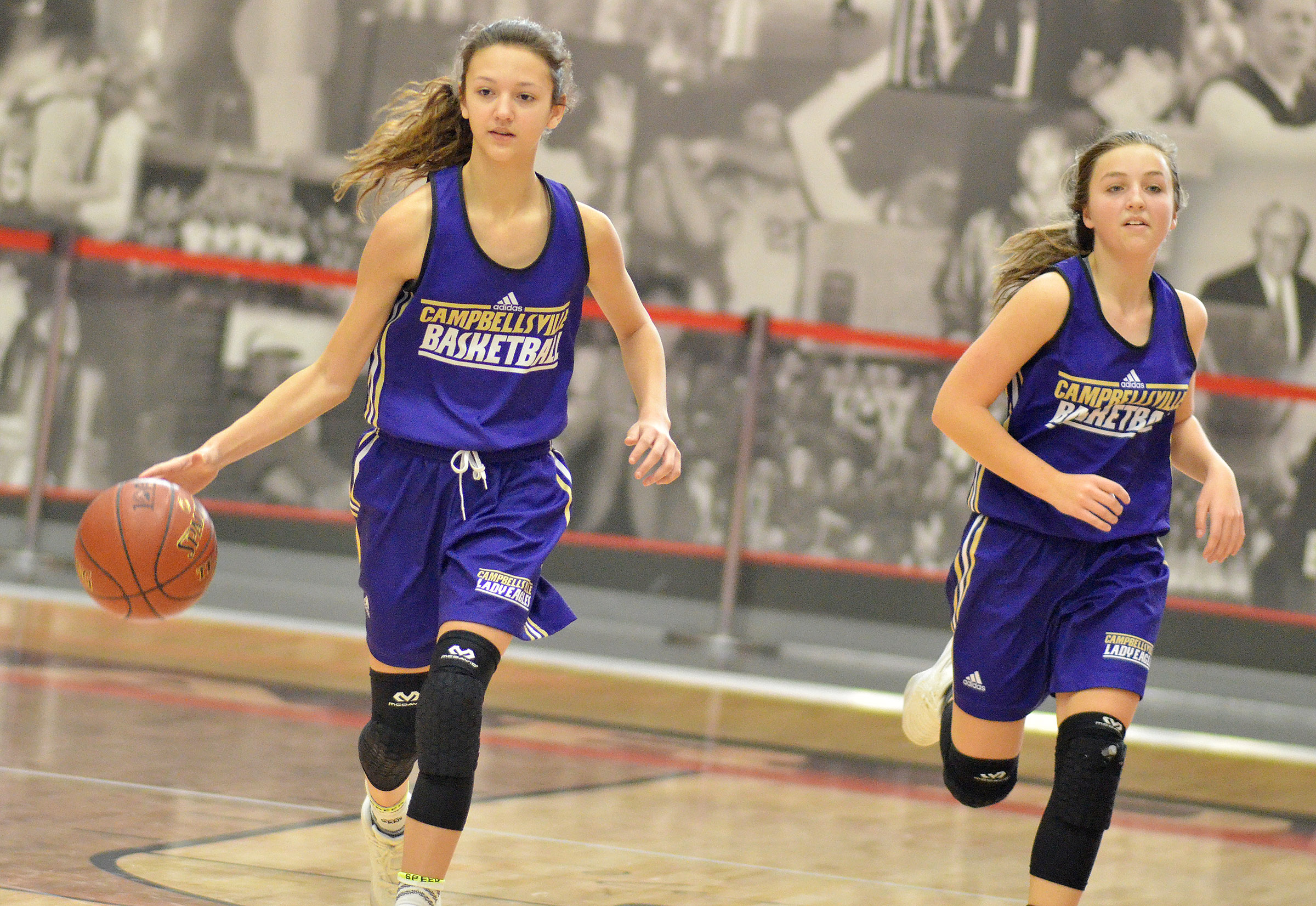 Campbellsville Middle School seventh-grader Bri Hayes dribbles down the court as eighth-grader Lainey Watson runs with her.