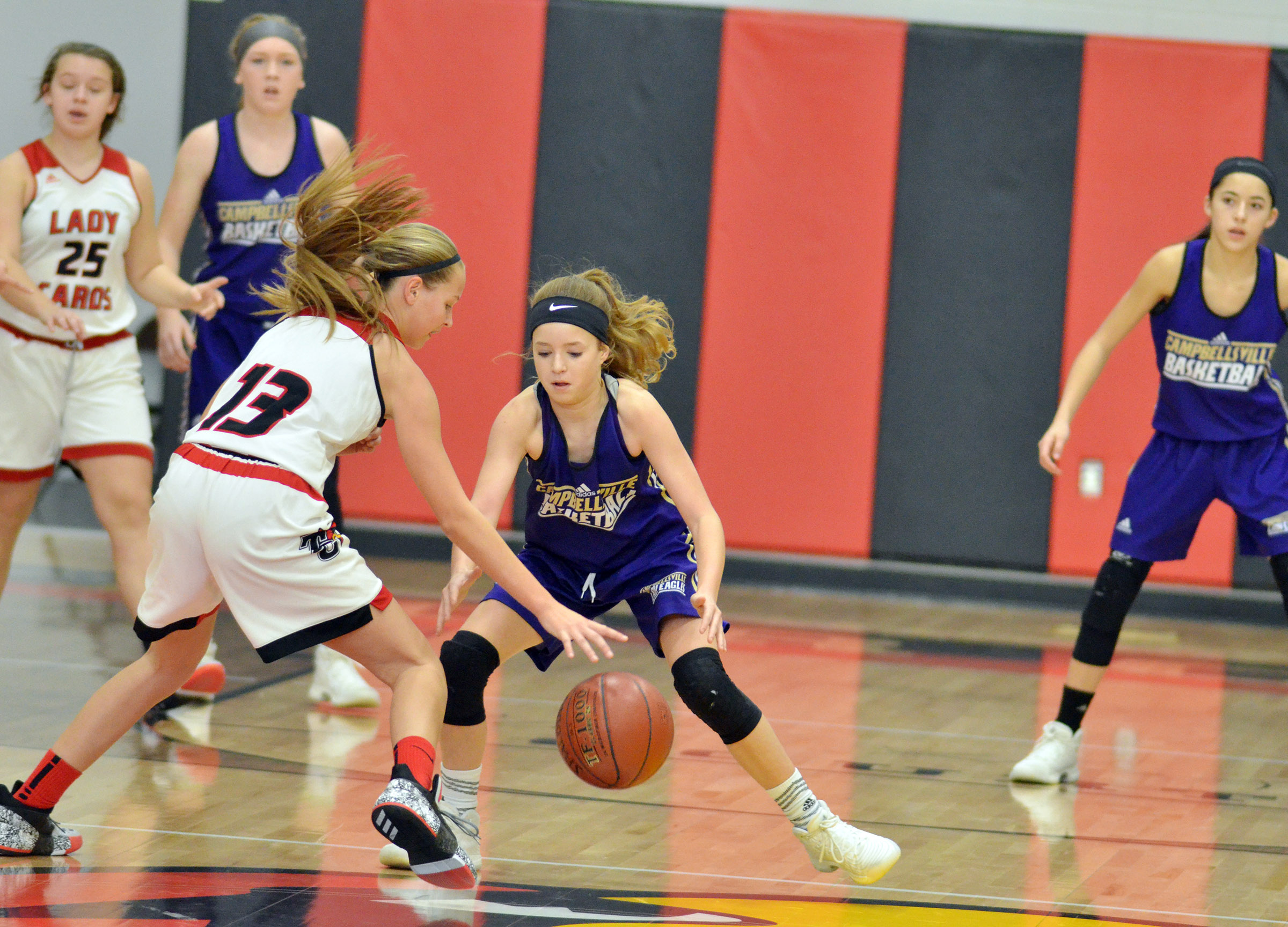 Campbellsville Middle School eighth-grader Rylee Petett tries to steal the ball.