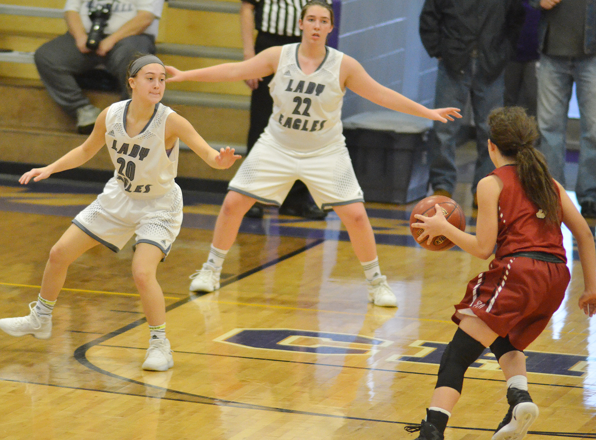 CHS sophomore Bailey Thompson, at left, and freshman Abi Wiedewitsch play defense.