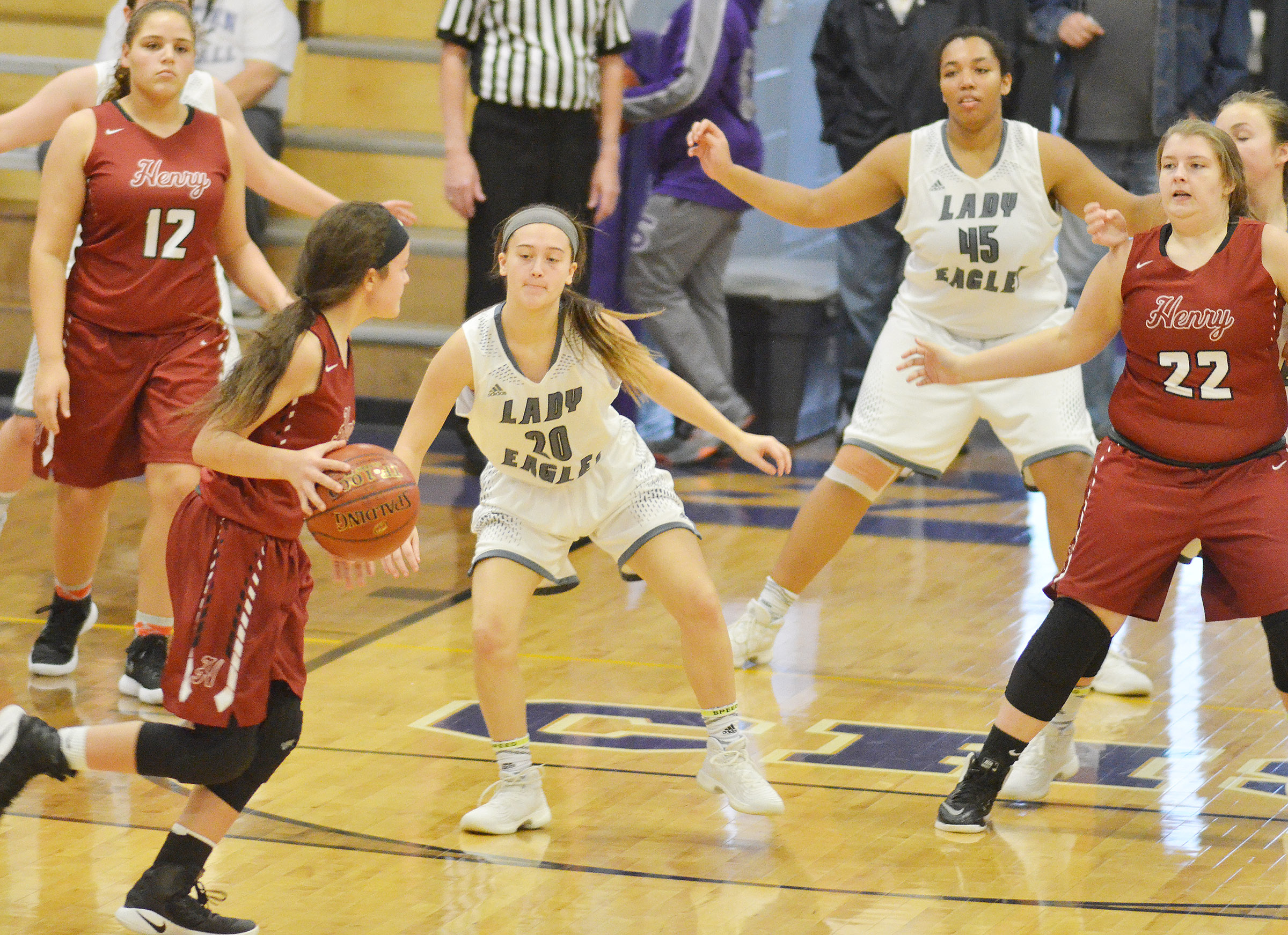 CHS sophomore Bailey Thompson, at left, and junior Malaya Hoskins play defense.