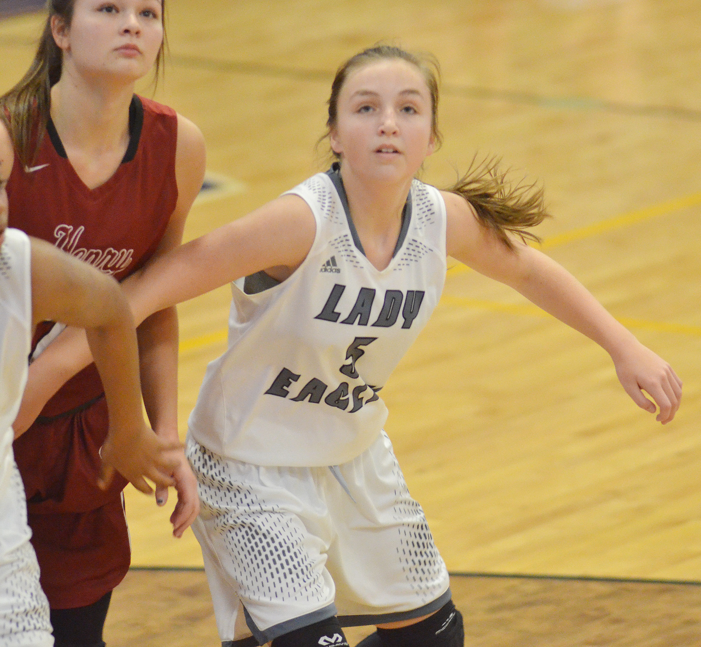 Campbellsville Middle School eighth-grader Lainey Watson looks for a rebound.