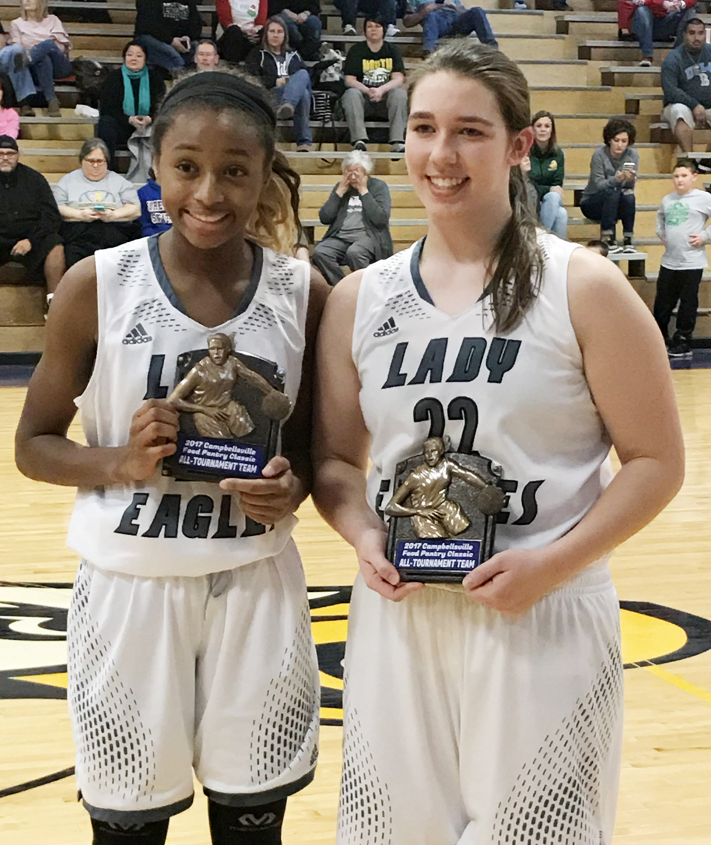 Campbellsville Middle School eighth-grader Bri Gowdy, at left, and CHS freshman Abi Wiedewitsch are named to the Food Pantry Classic all-tournament team.