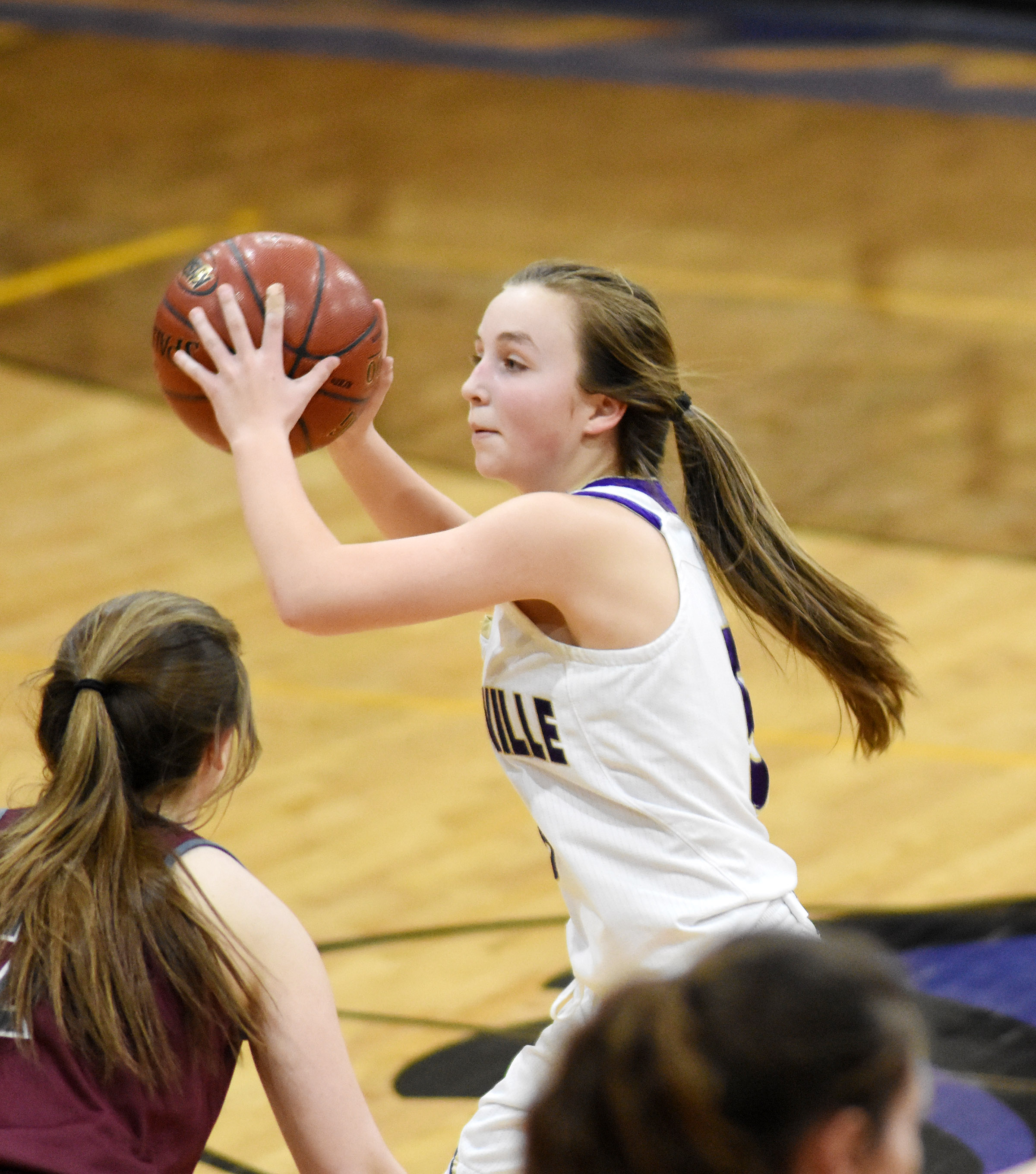 Campbellsville Middle School eighth-grader Lainey Watson passes.
