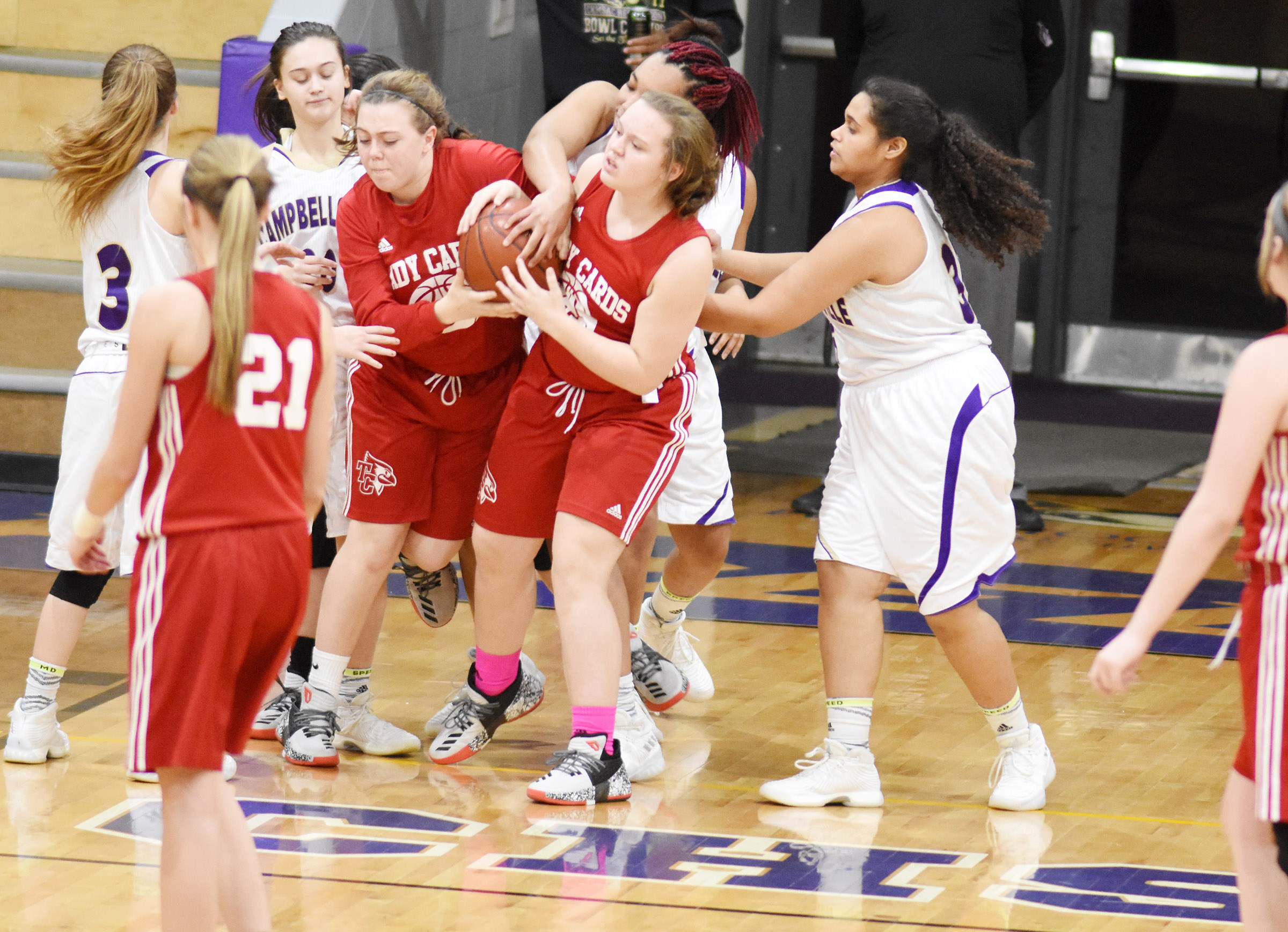 CHS girls' basketball junior varsity players fight for the ball.