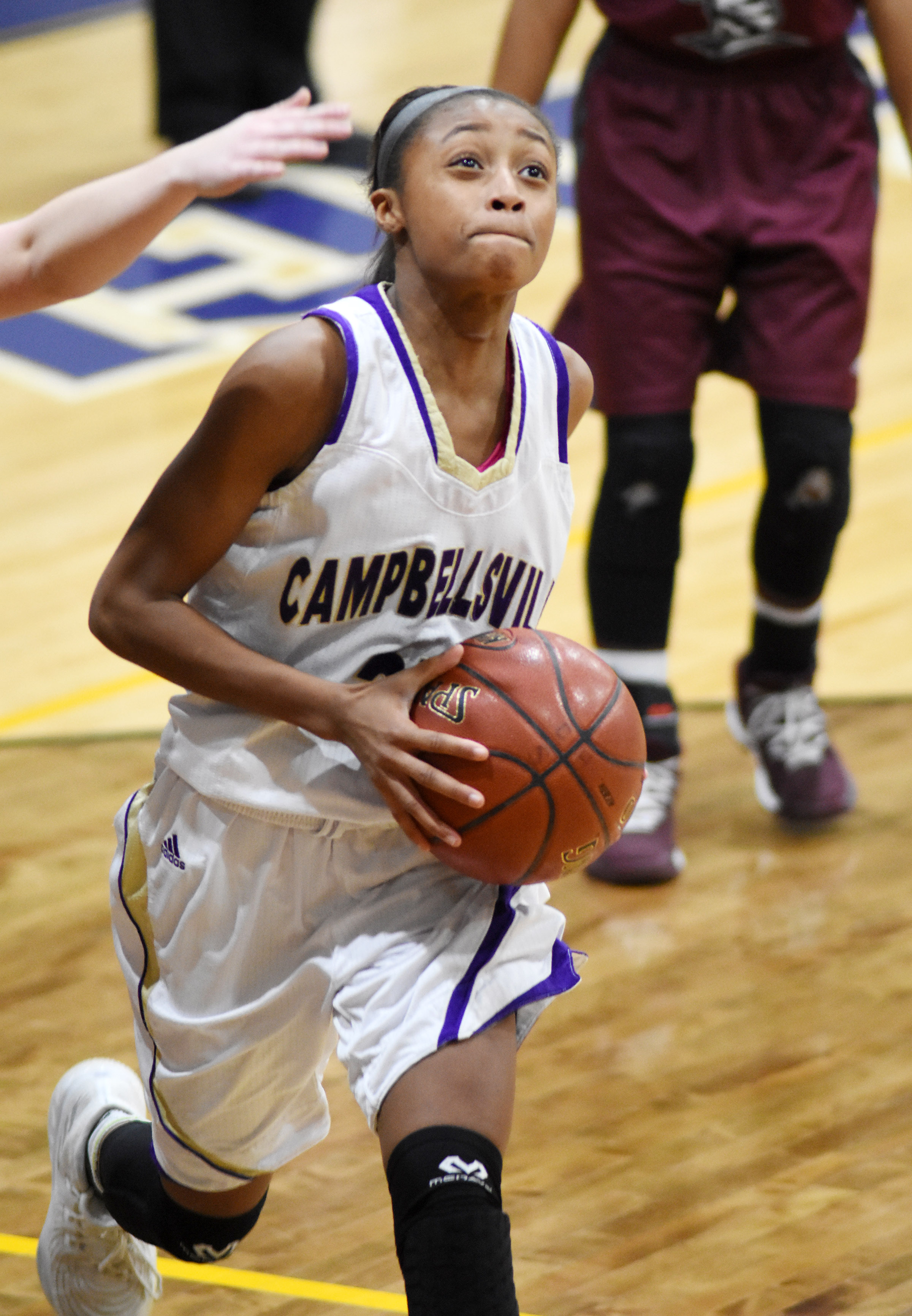Campbellsville Middle School eighth-grader Bri Gowdy scores two points.