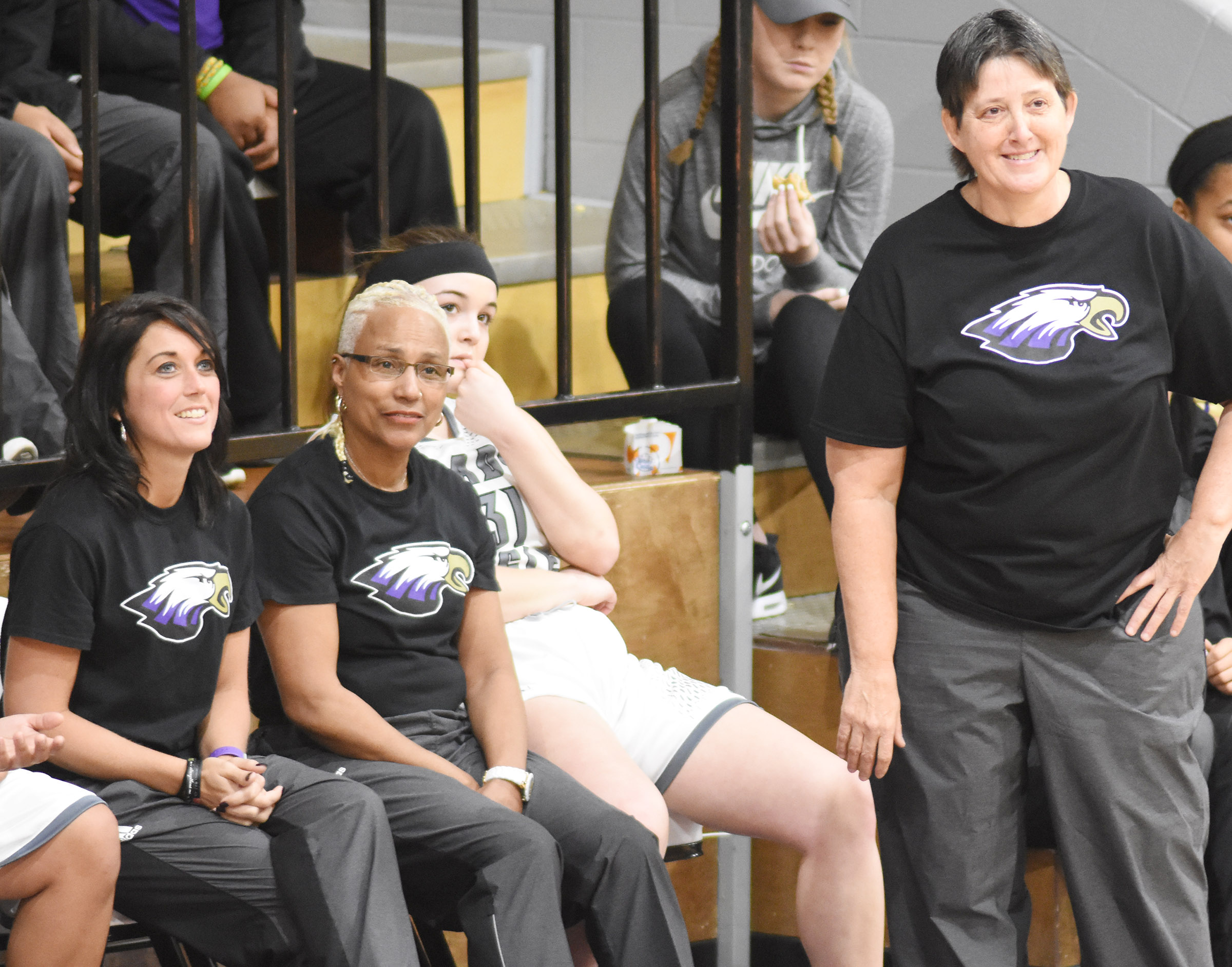 CHS girls' basketball assistant coaches, from left, Natalia Warren, Debbie Gowdy-Smith and Katie Wilkerson smile as their players score.