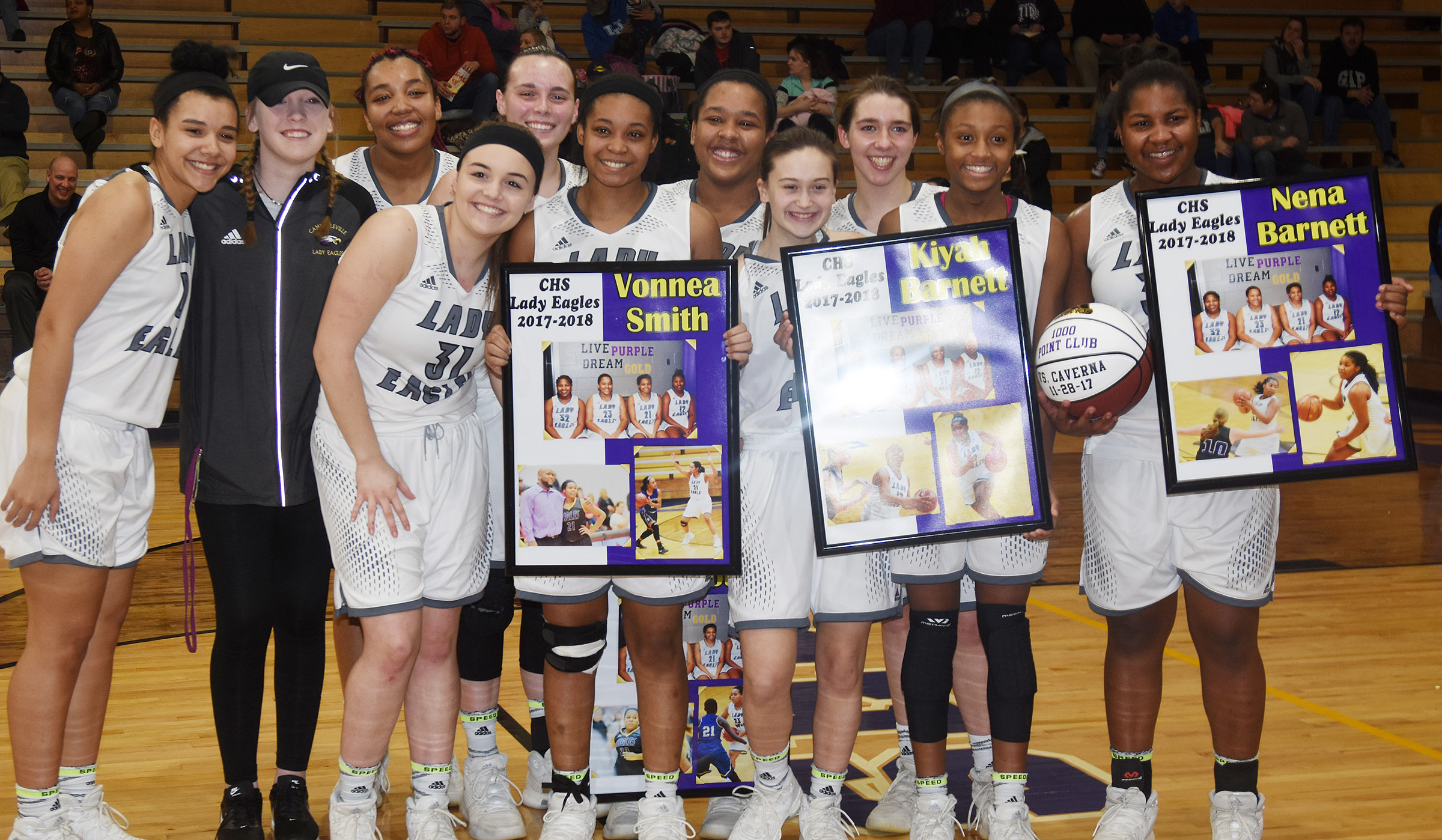 CHS girls' basketball players pose for a photo with senior players Vonnea Smith, Kayla Young and Nena Barnett.