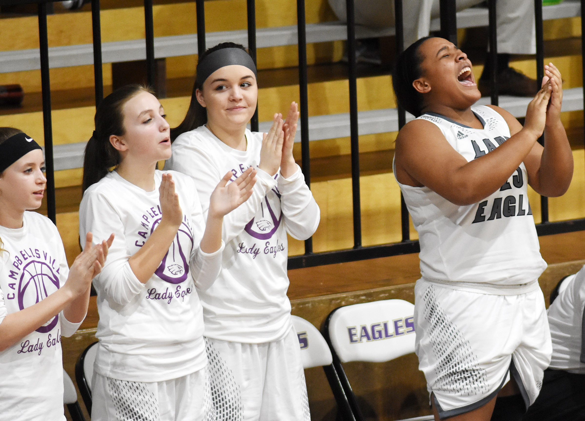 CHS senior Kayla Young and her teammates, from left, Campbellsville Middle School eighth-graders Rylee Petett and Lainey Watson and freshman Kenzi Forbis cheer as their team defeats Adair County.