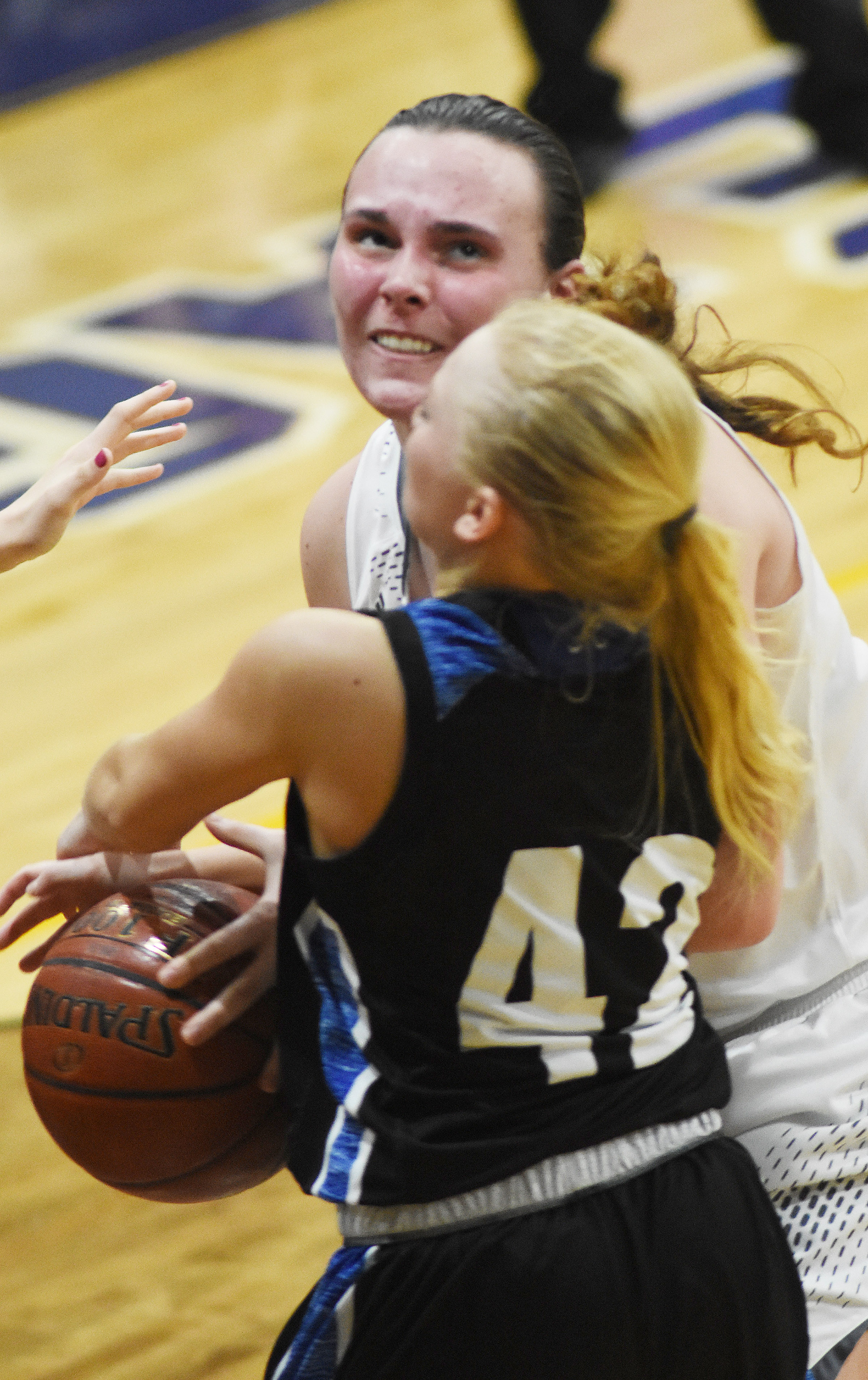 CHS sophomore Katelyn Miller drives the ball for two points.