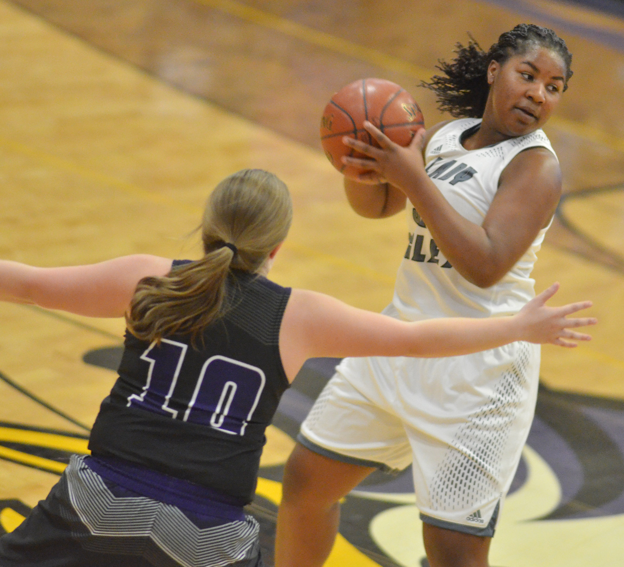 CHS senior Kiyah Barnett looks to pass.