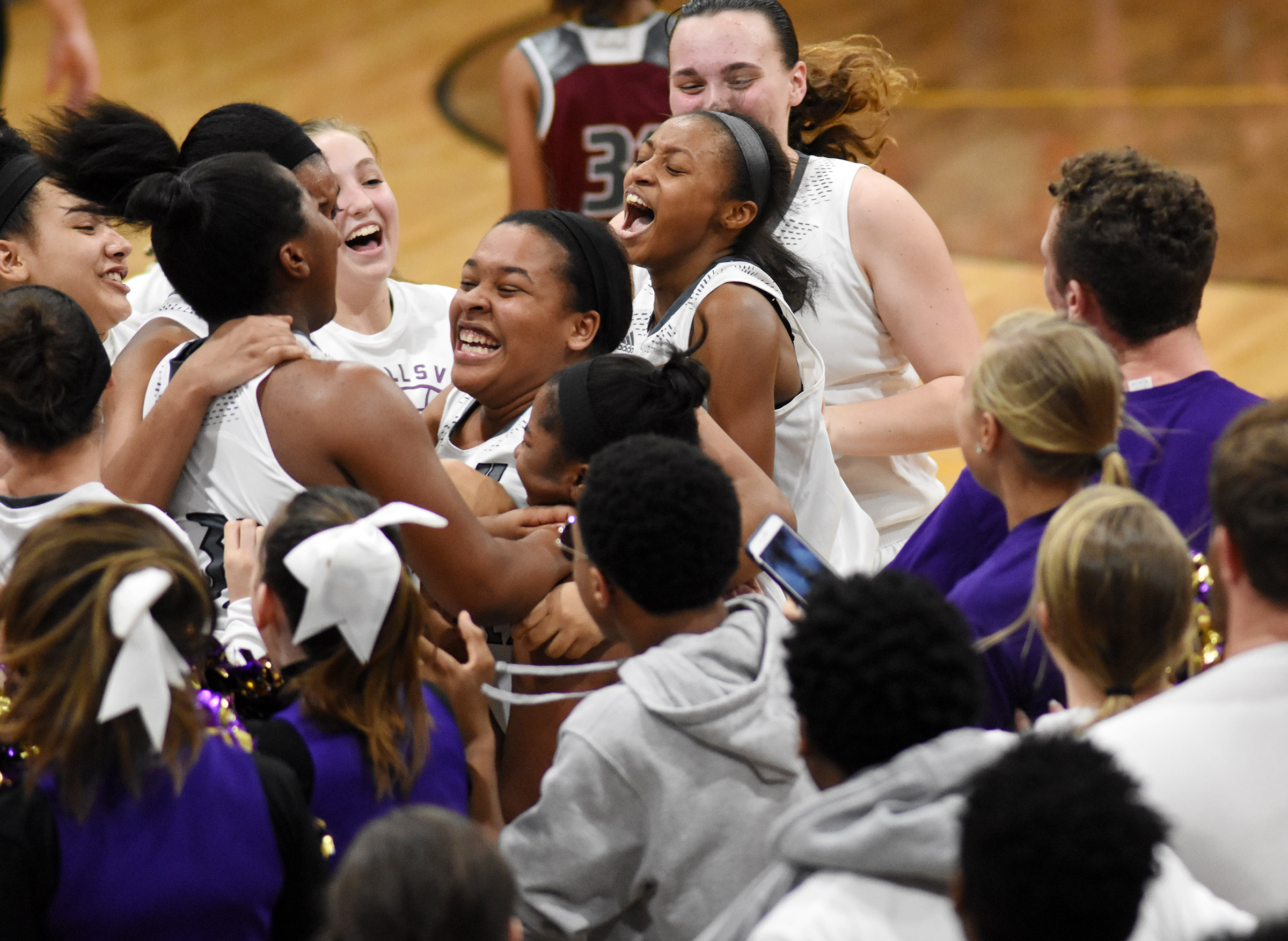 CHS girls' basketball players celebrate their win.