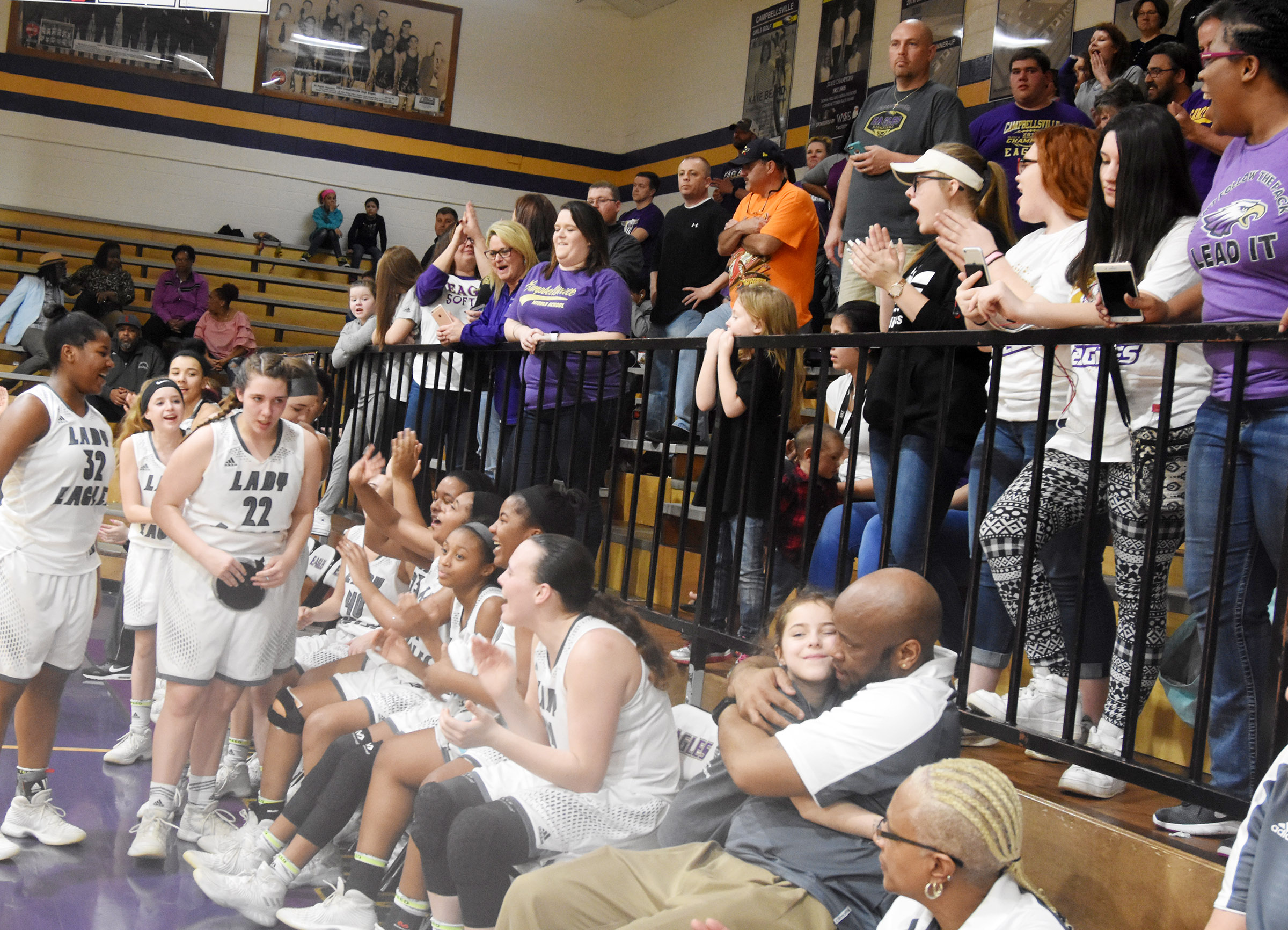 CHS girls' basketball players and fans celebrate.
