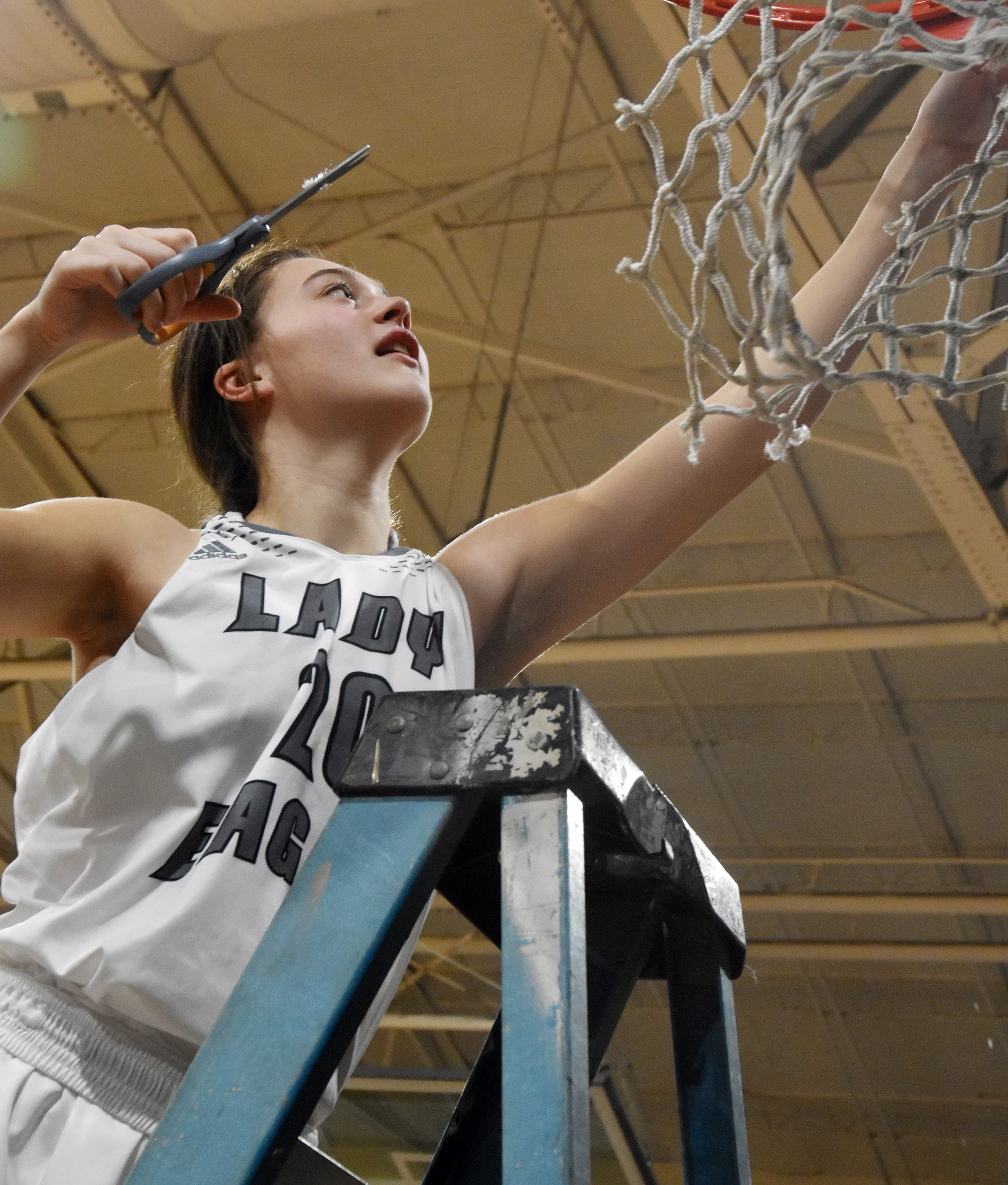 Campbellsville Middle School eighth-grader Bri Gowdy cuts down the net.