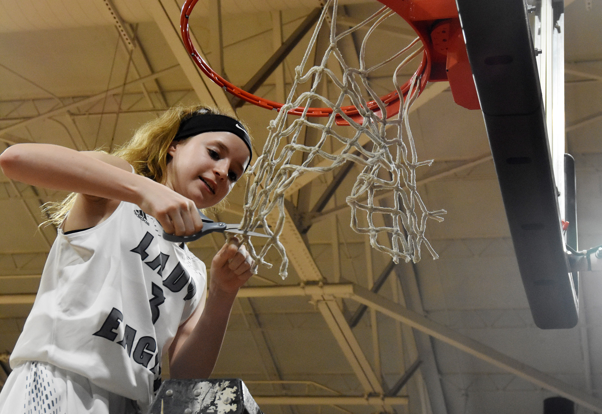 CHS sophomore Bailey Thompson cuts down the net.
