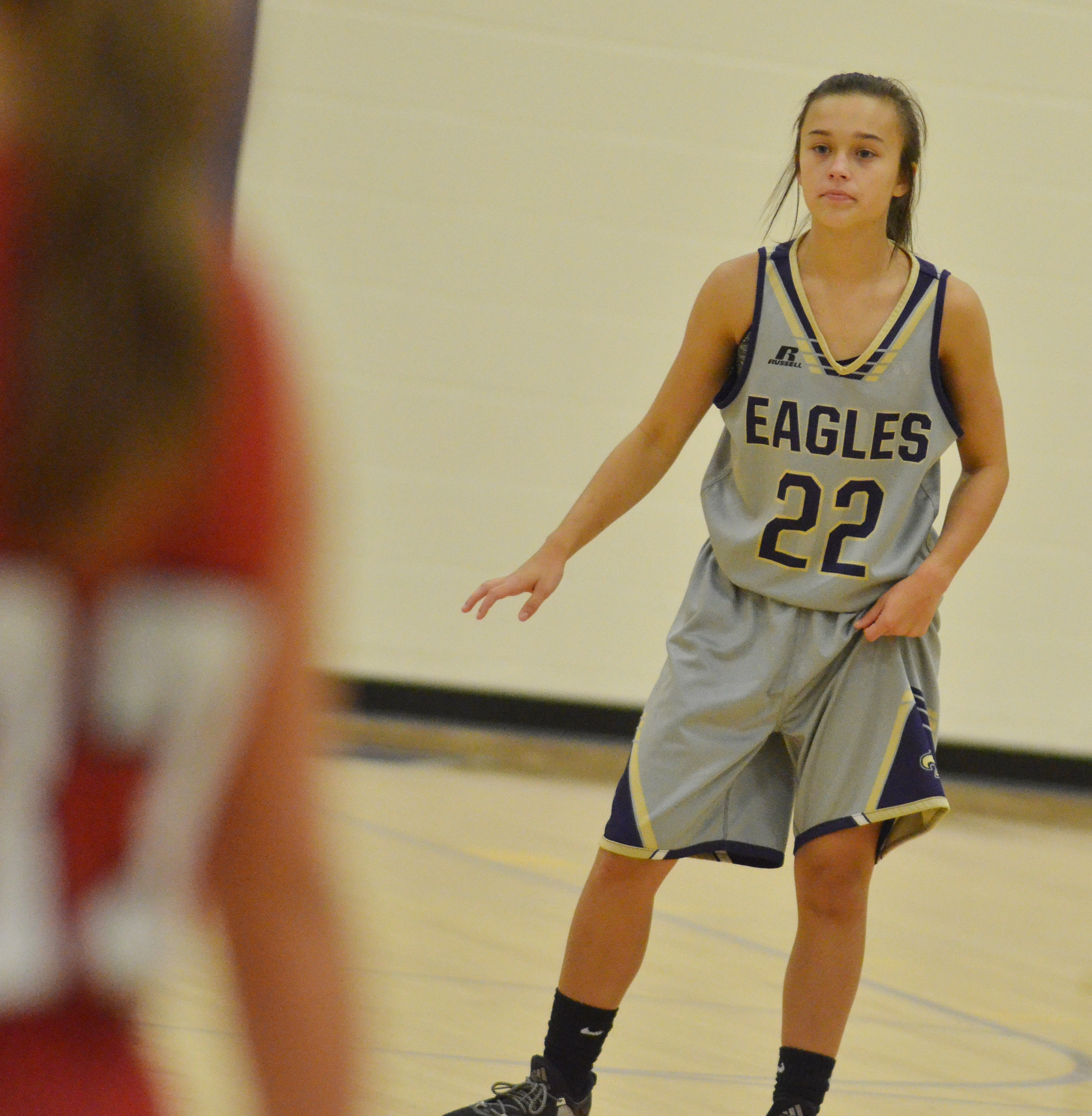 CMS eighth-grader Tayler Thompson plays defense.