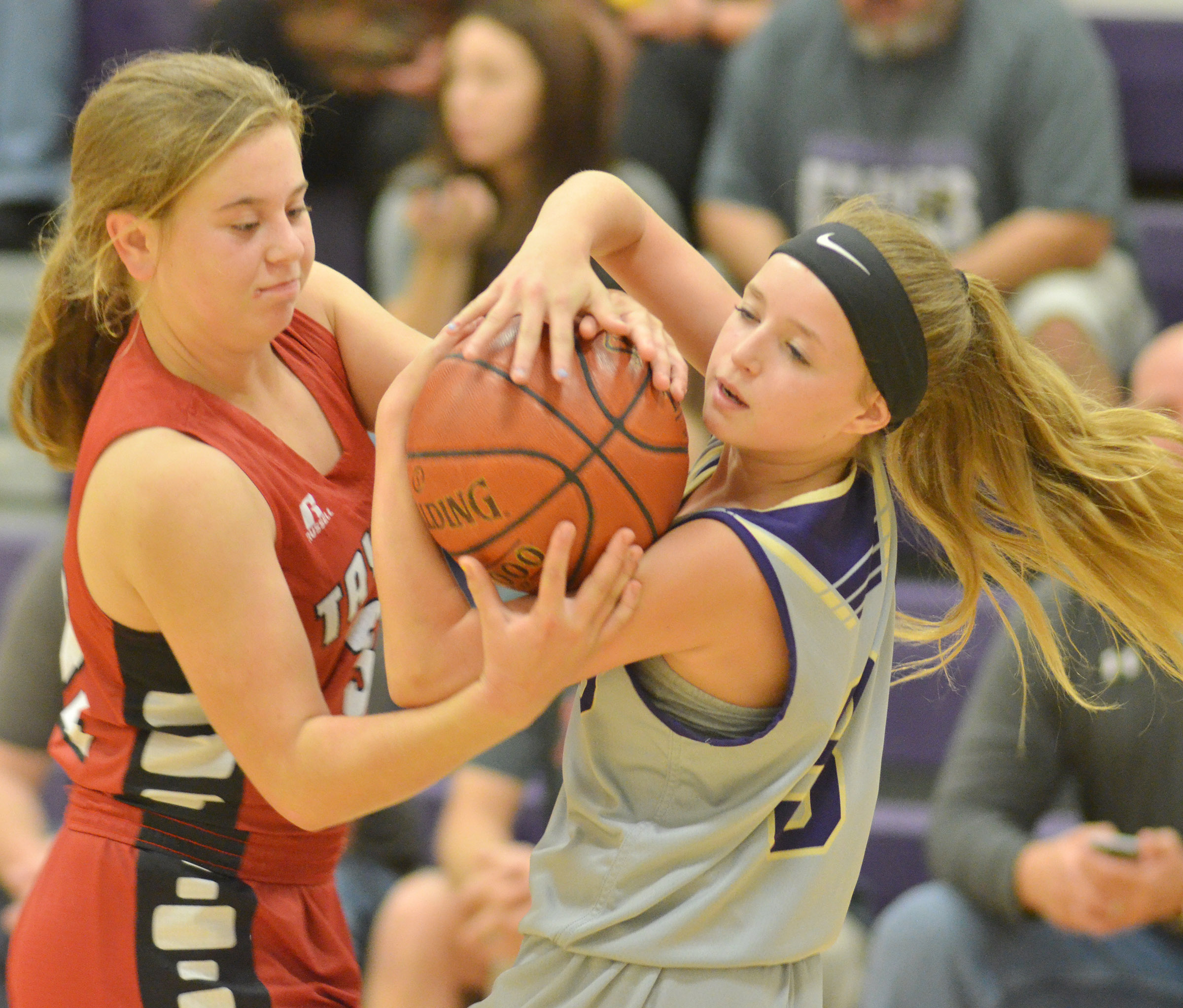 CMS eighth-grader Rylee Petett battles for the ball.