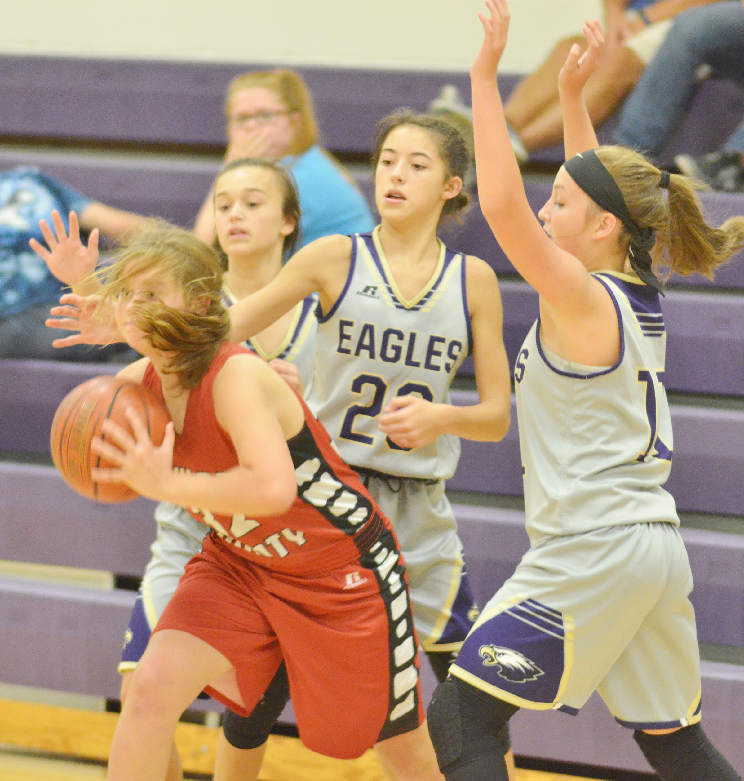 CMS eighth-graders, from left, Tayler Thompson, Kaylyn Smith and Lainey Watson put pressure on a Taylor County player.