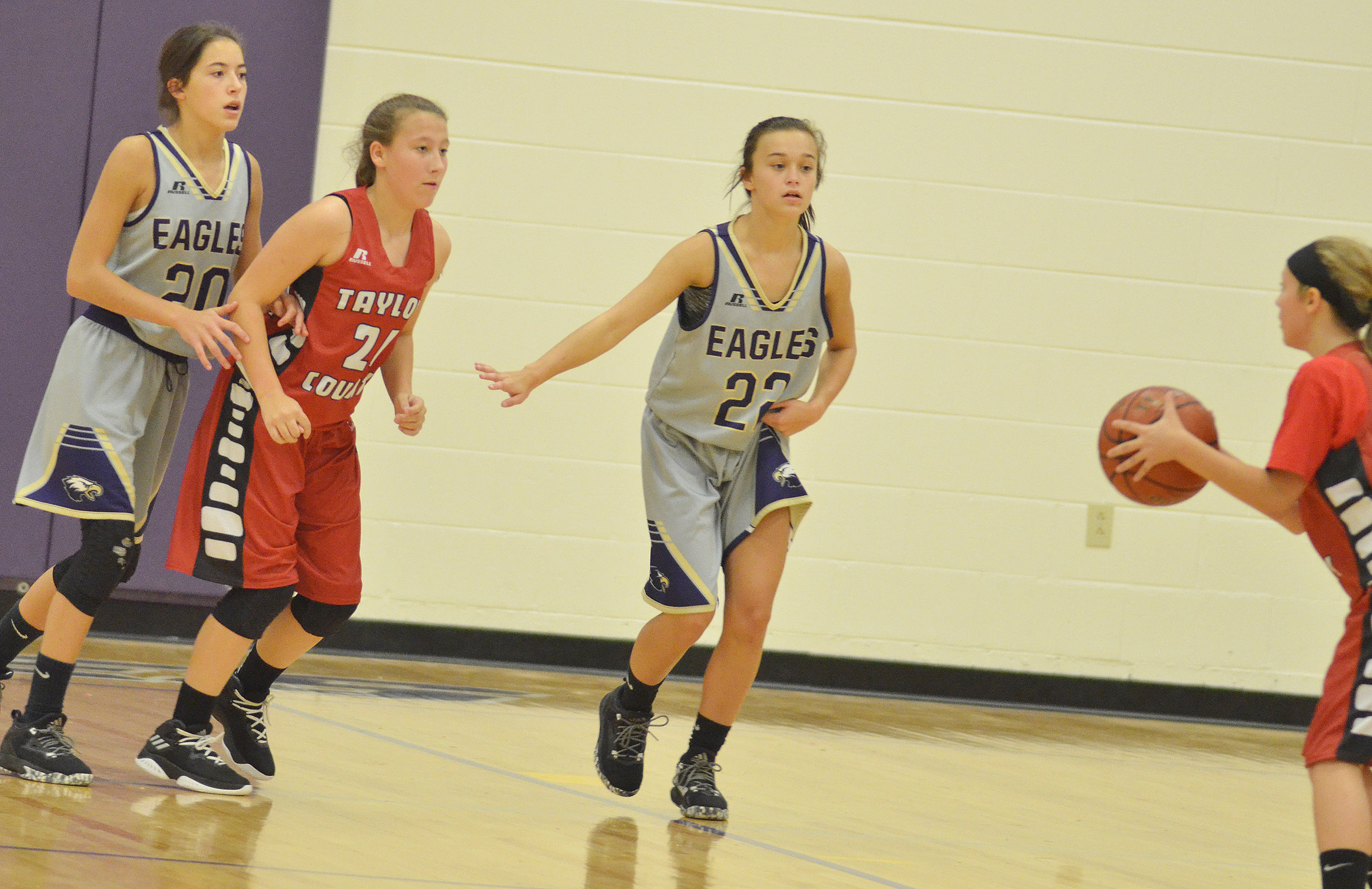 CMS eighth-graders Kaylyn Smith, at left, and Tayler Thompson play defense.