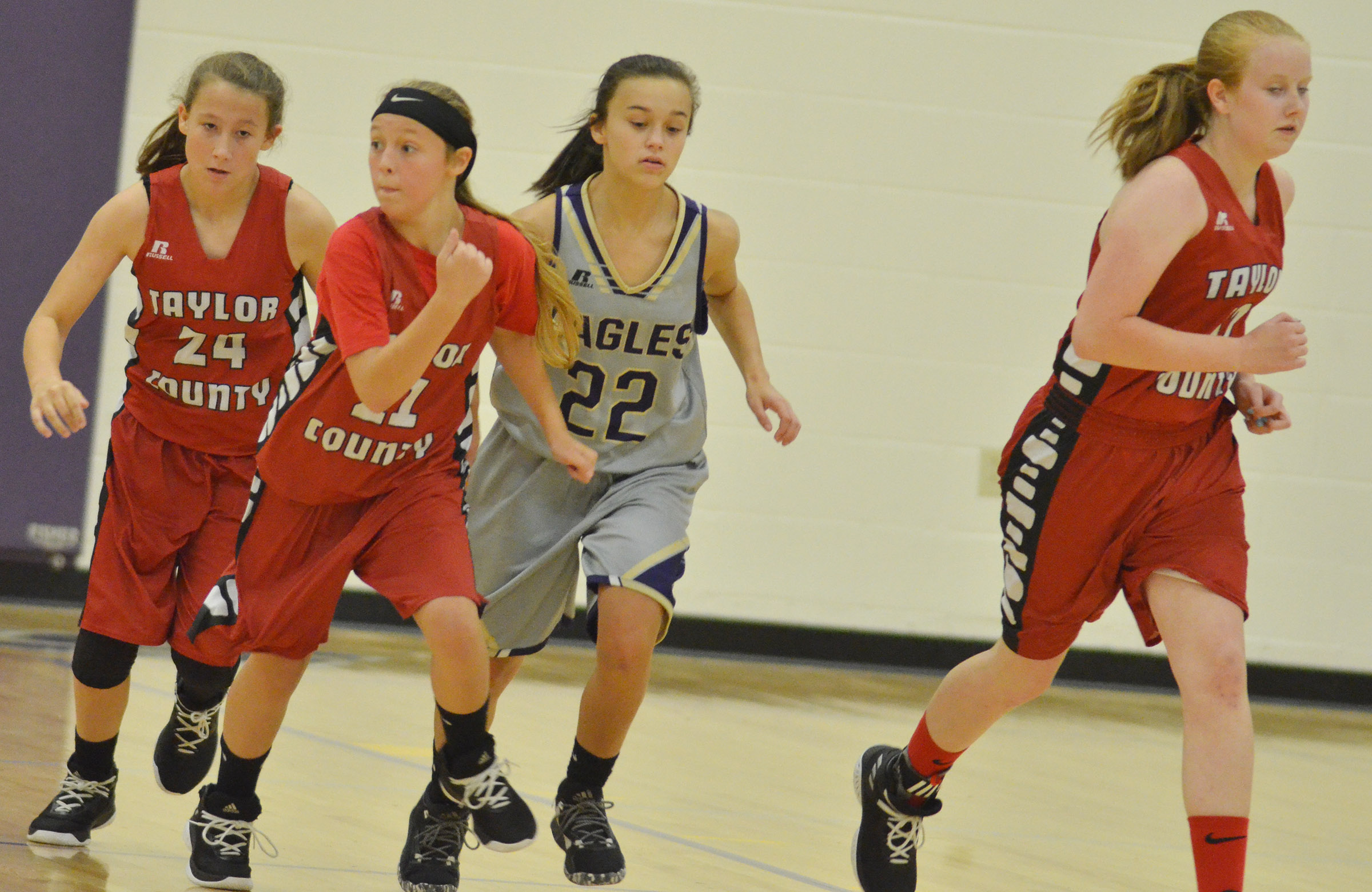CMS eighth-grader Tayler Thompson runs down court.
