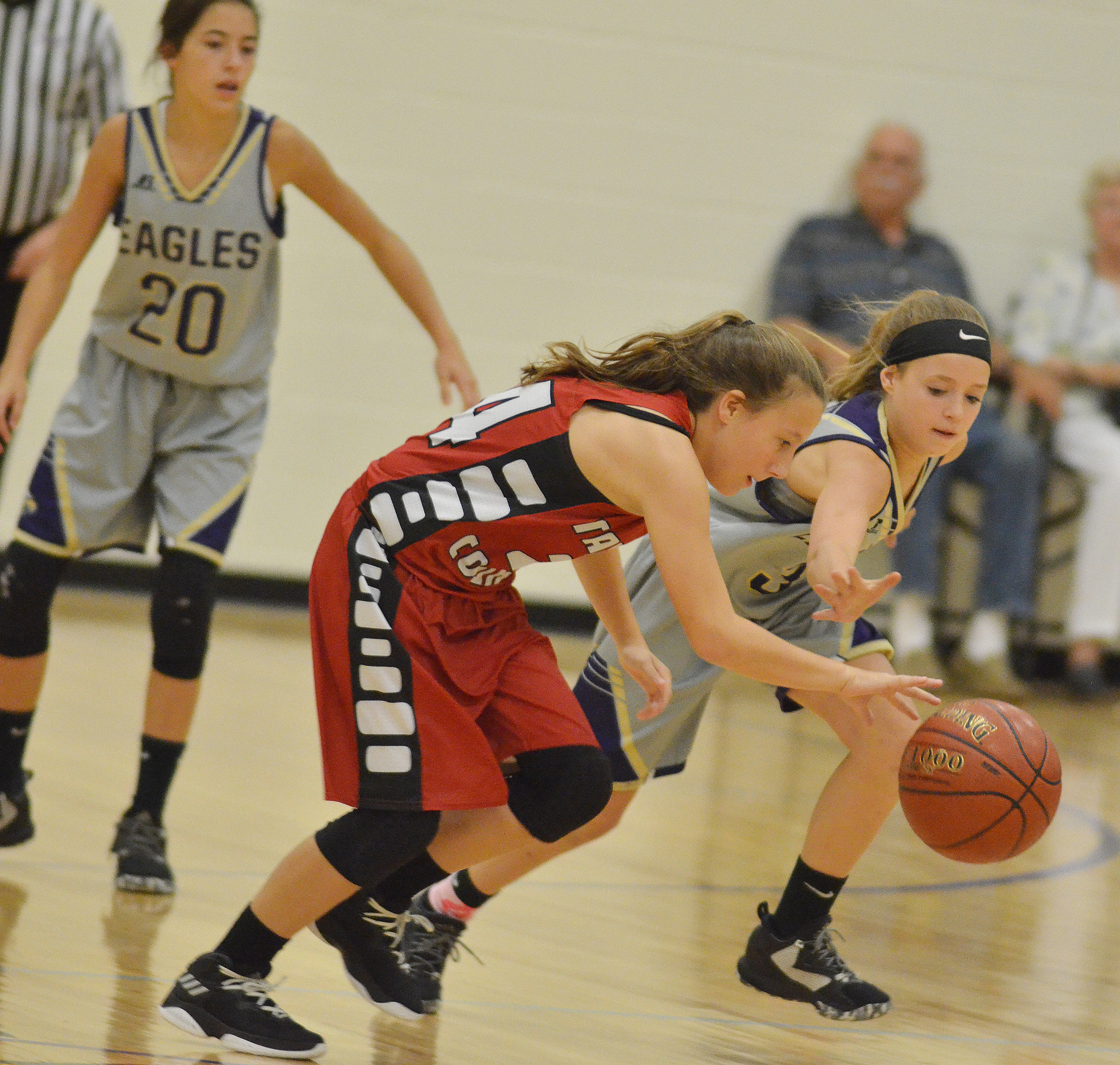 CMS eighth-grader Rylee Petett fights for the ball.