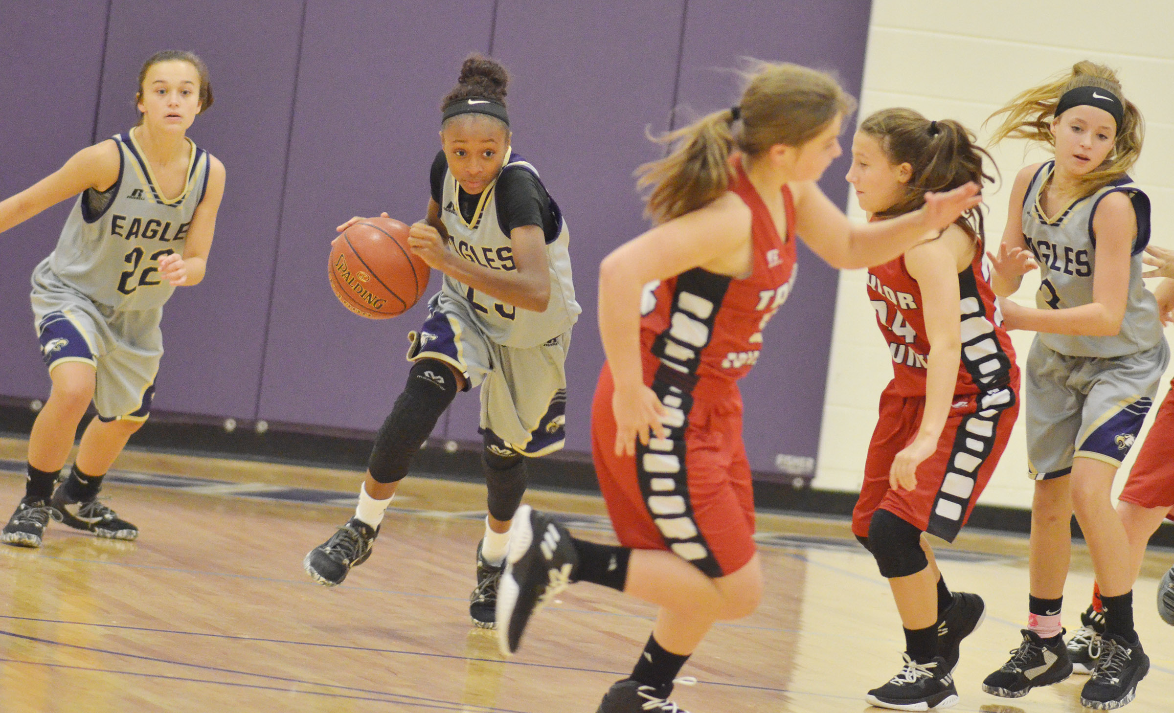 CMS eighth-grader Bri Gowdy, center, steals the ball and heads to the goal.