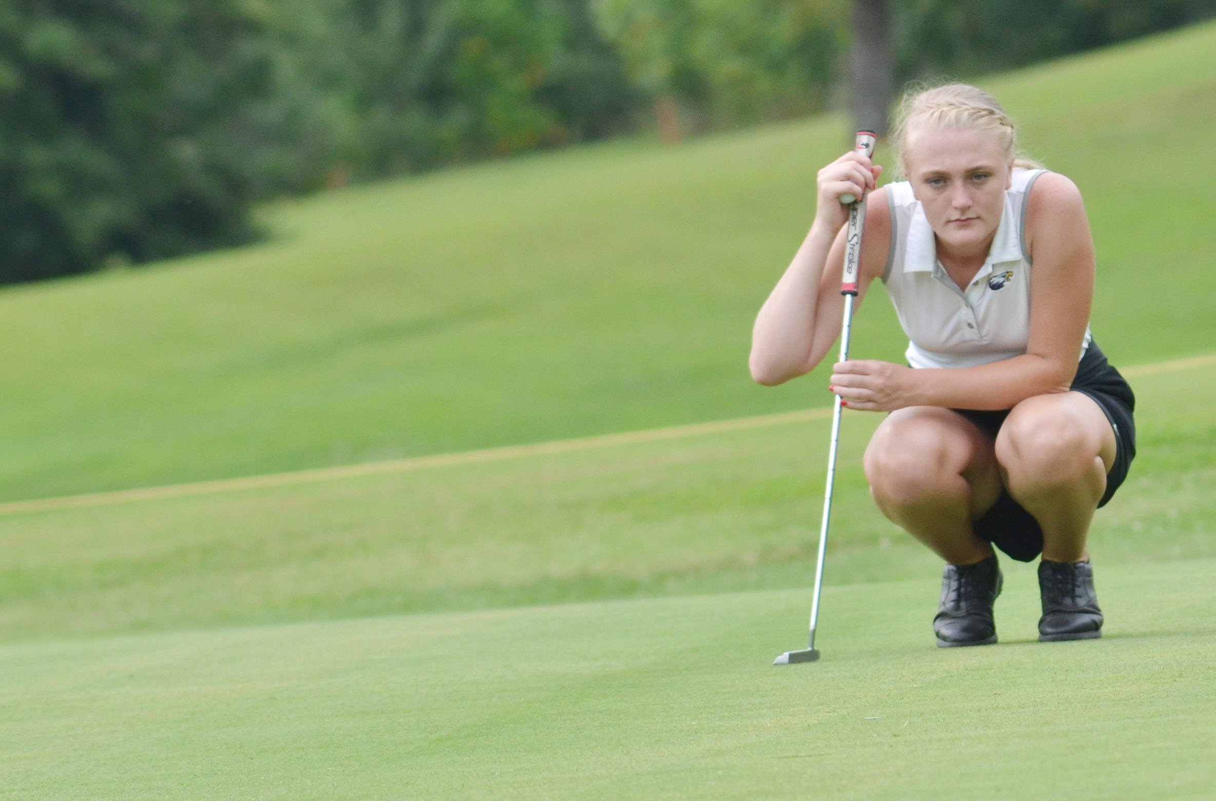 "CHS junior Abbie Dicken lines up a shot in the All ""A"" region tournament."
