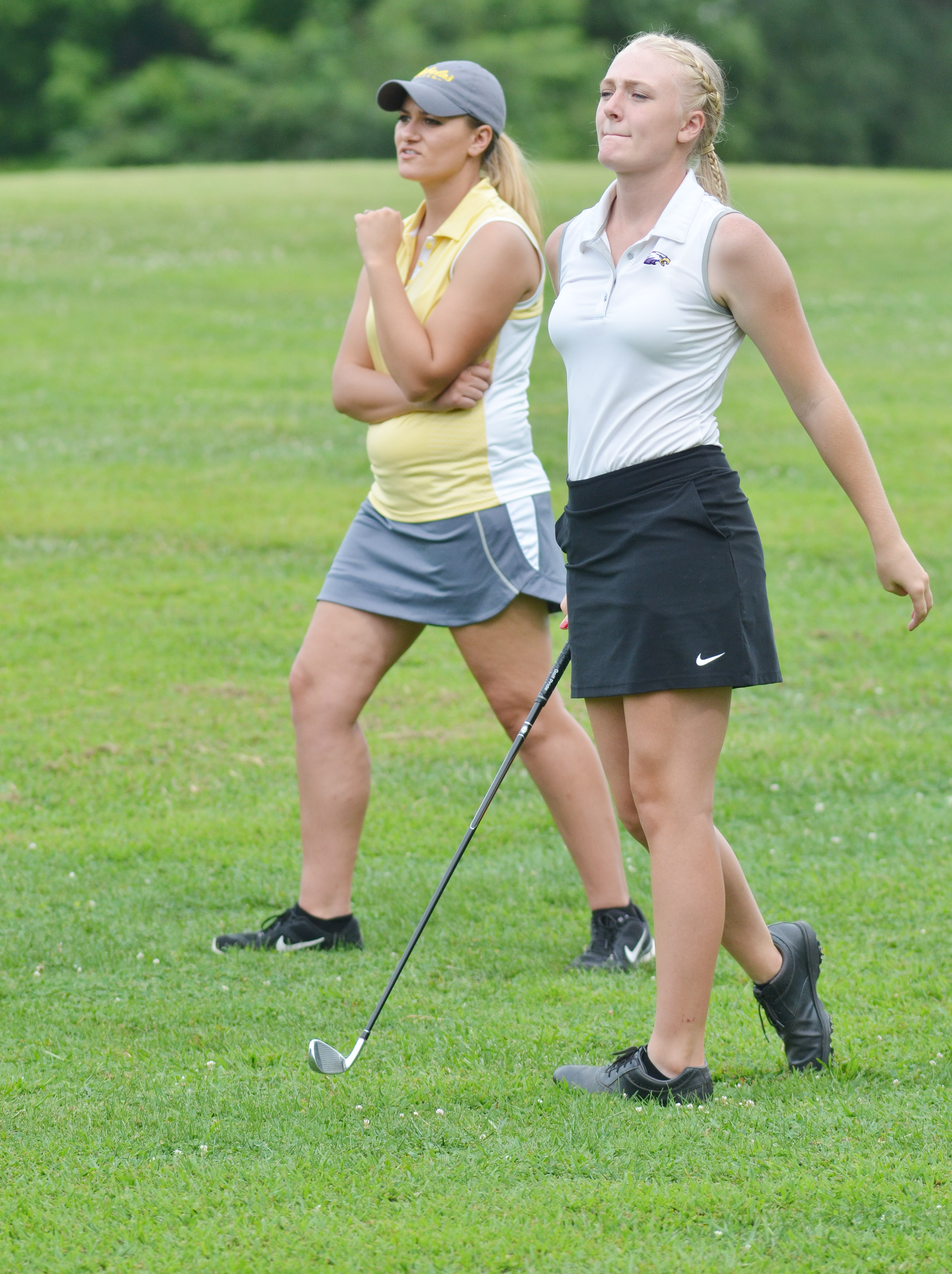"CHS junior Abbie Dicken sets up a shot in the All ""A"" region tournament, with guidance from head coach Ashley Goodin."