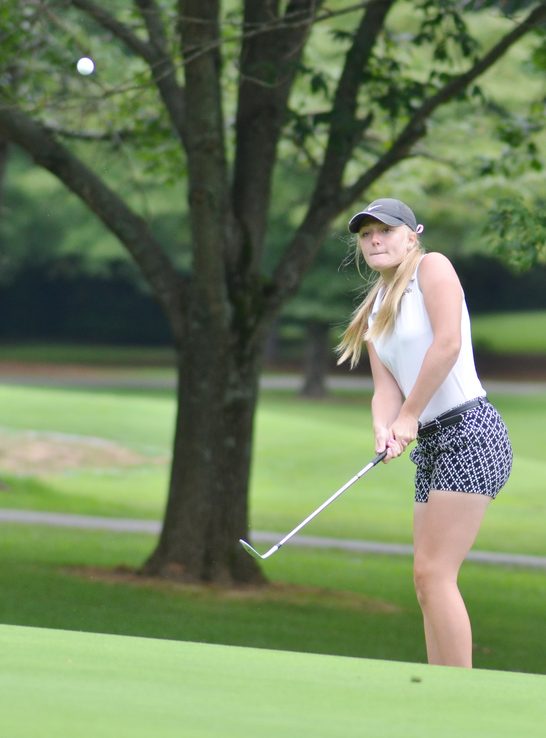 CHS junior Abbie Dicken chips the ball onto the green.