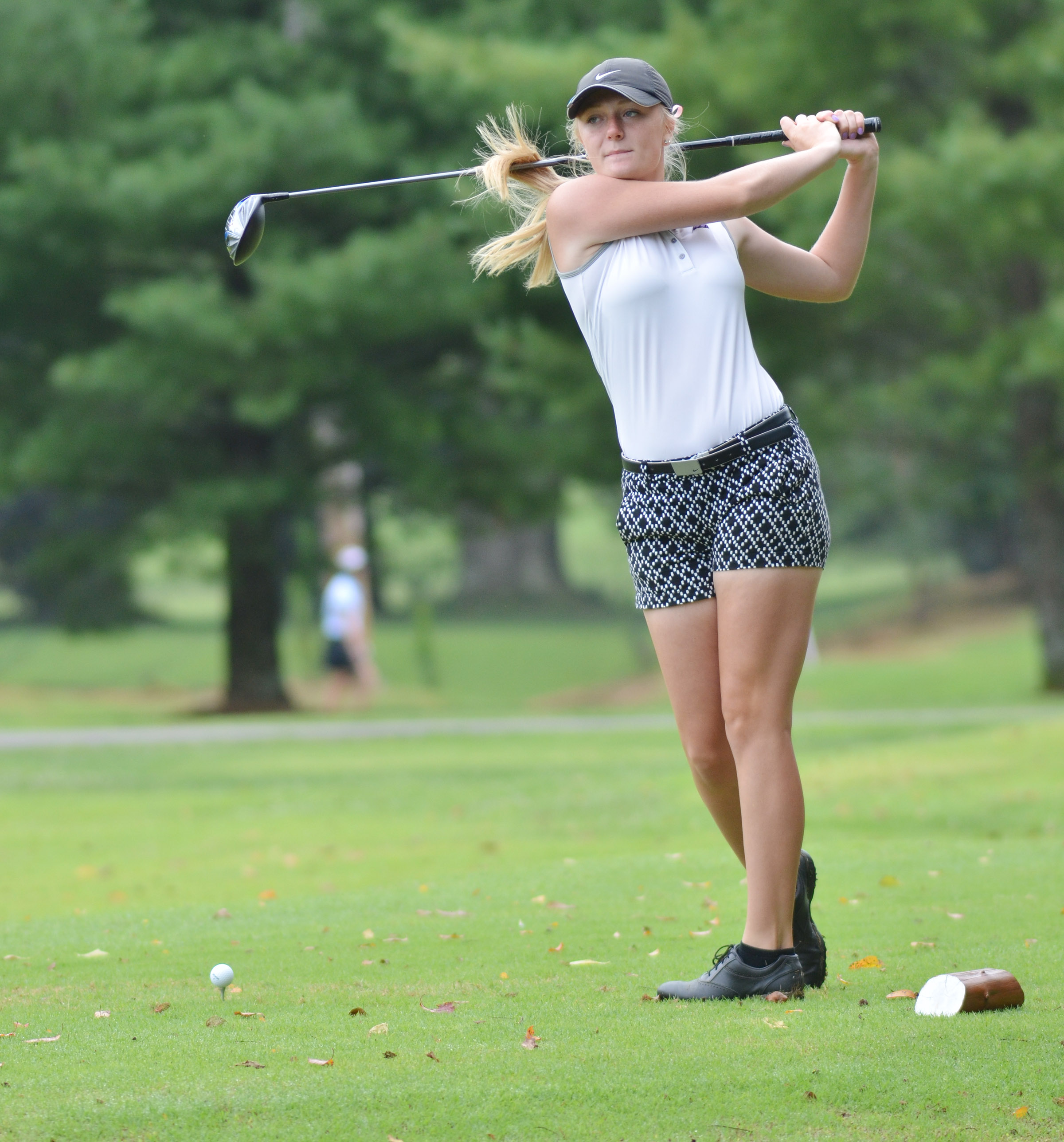 CHS junior Abbie Dicken takes a practice swing.