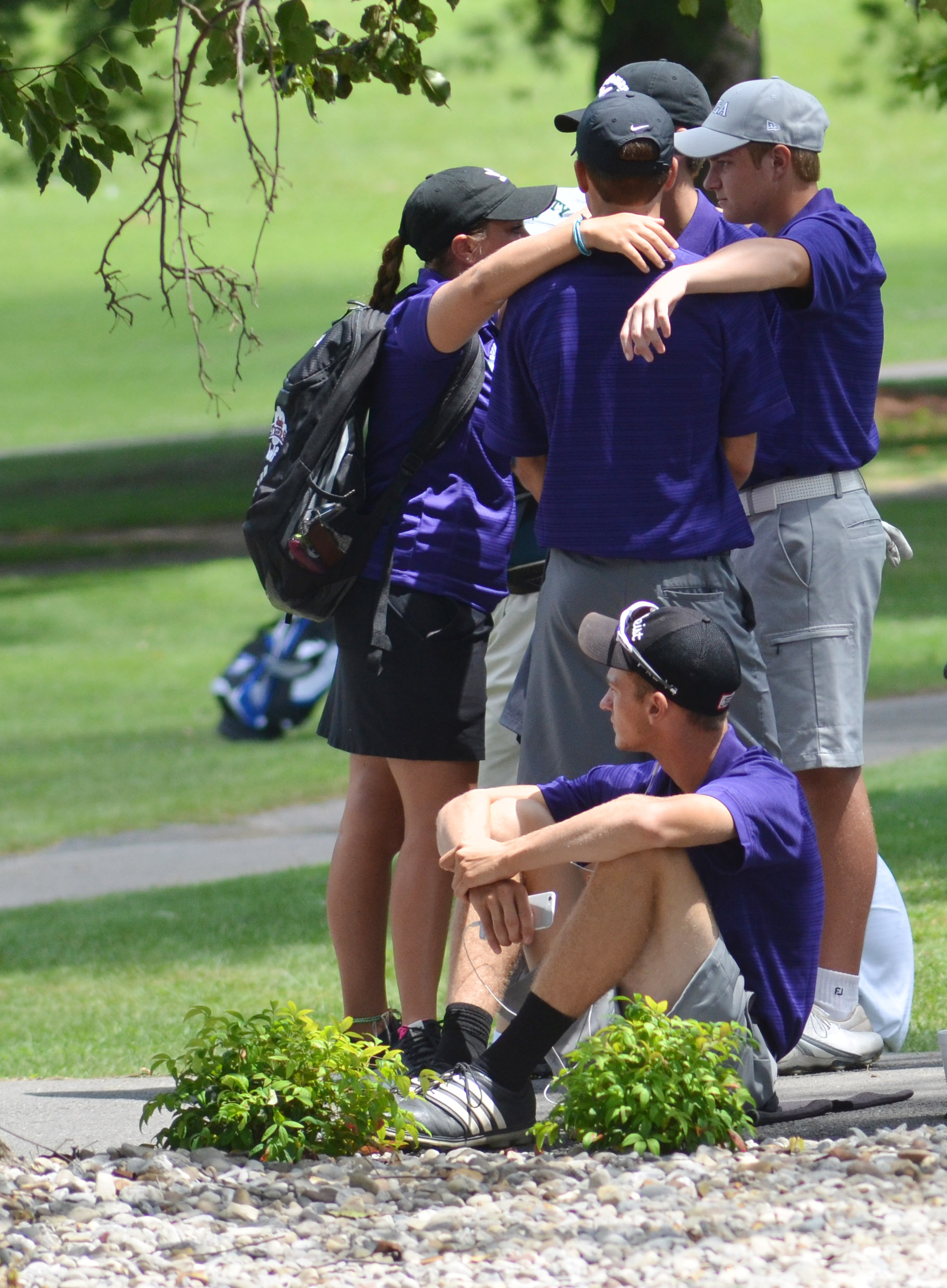 CHS boys' golf coach Cassidy Decker talks with her players before they play.