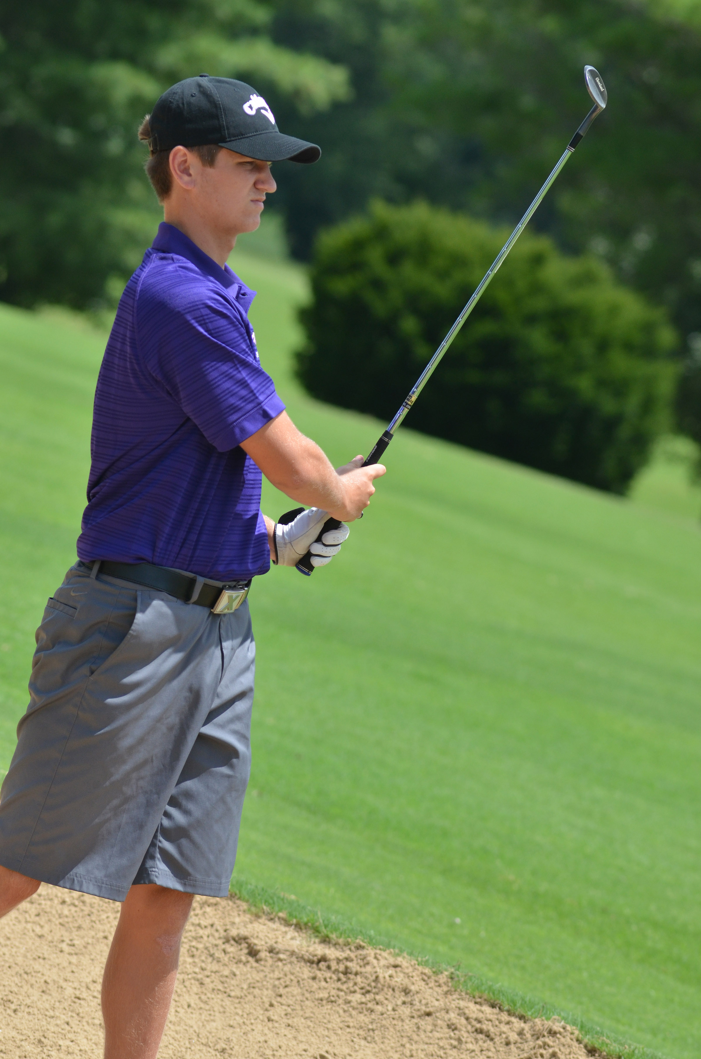 CHS junior Myles Murrell watches to see where his ball lands.