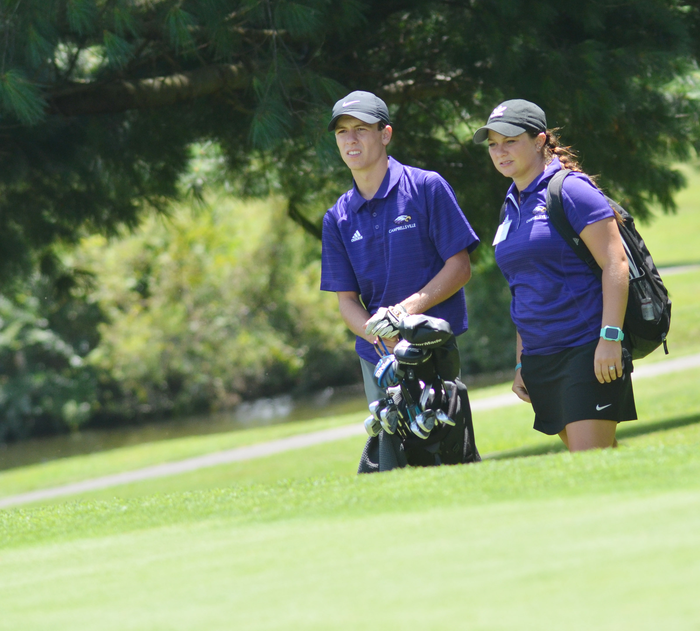 CHS junior Layton Hord talks to coach Cassidy Decker before he putts.