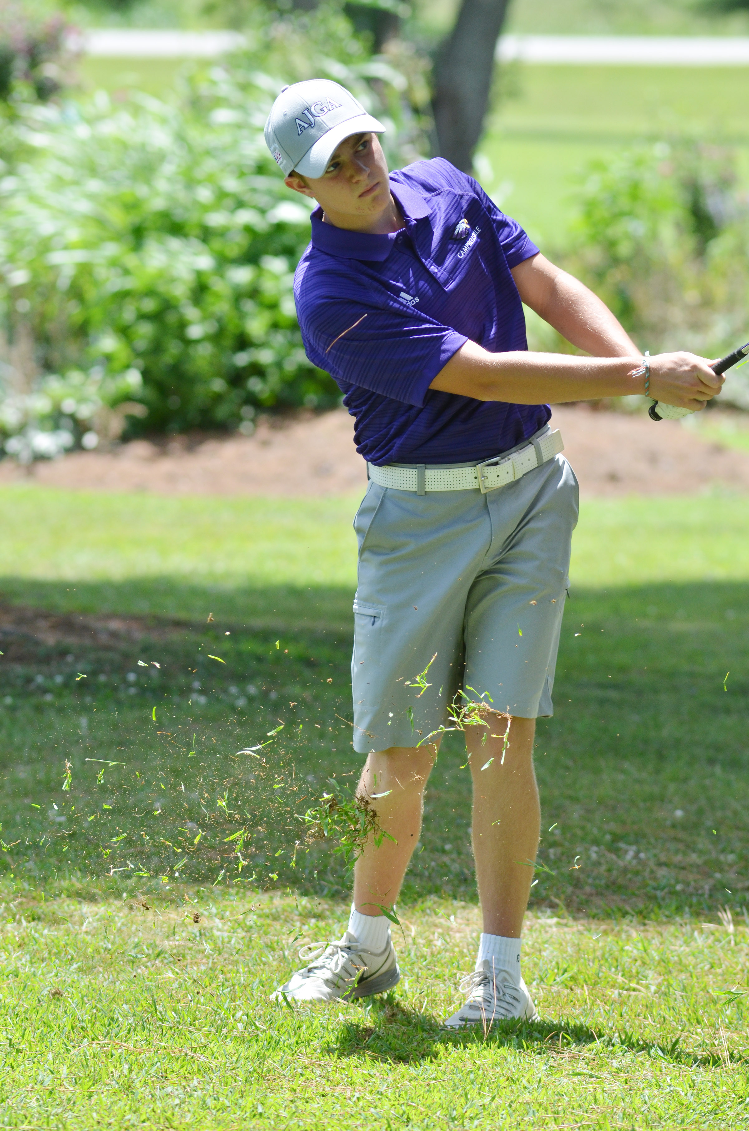 CHS senior Alex Doss hits the ball onto the green.