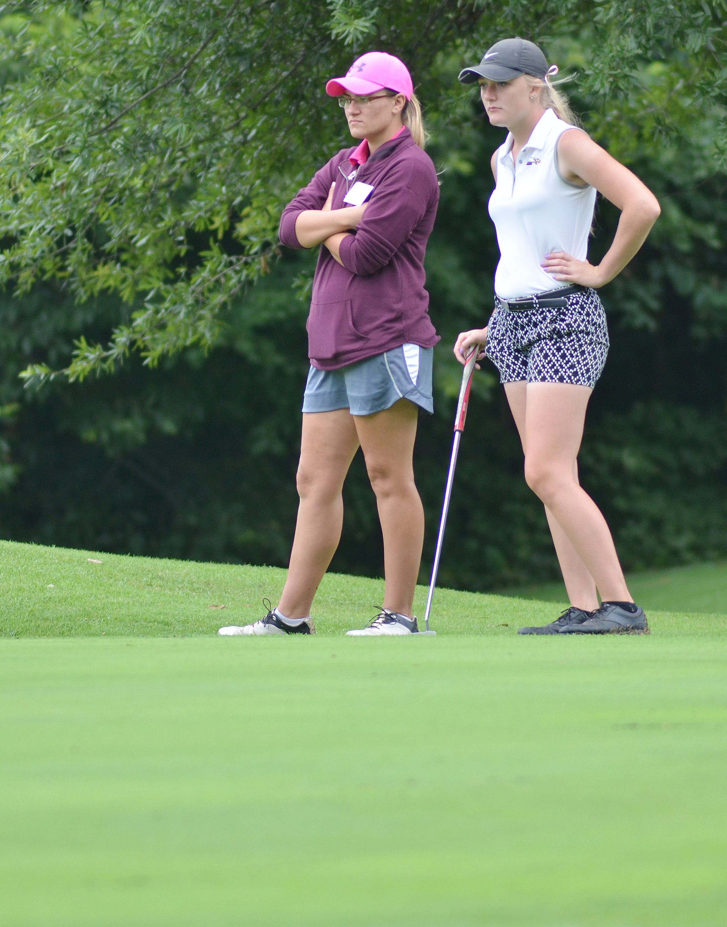 CHS junior Abbie Dicken talks to coach Ashley Goodin as she gets set to putt.