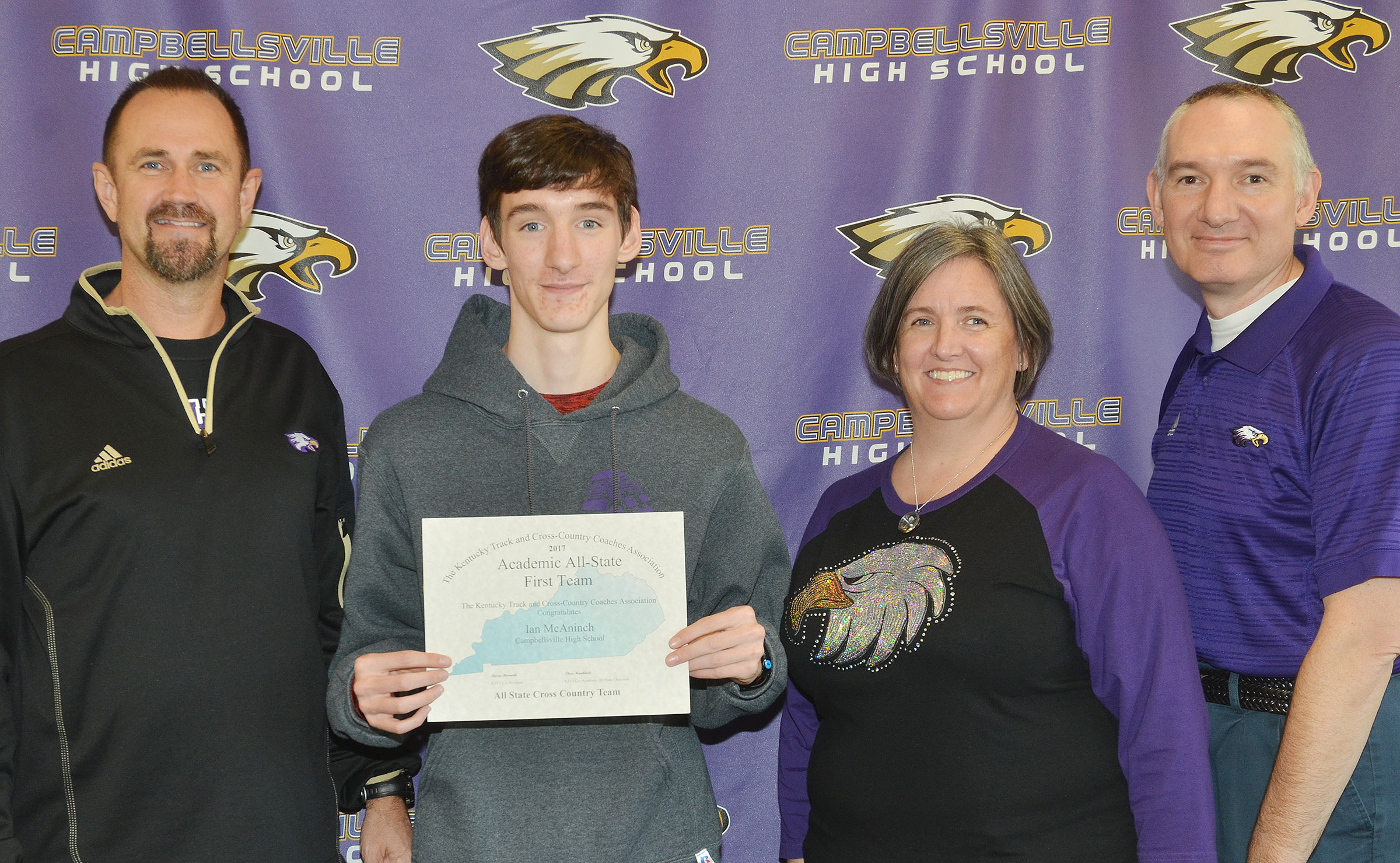 The Kentucky Track and Cross Country Coaches Association recently named Ian McAninch, a CHS junior, to the Academic All-State First Team. From left are CHS cross country coach Steve Doss, Ian McAninch and his parents Lori and Troy.