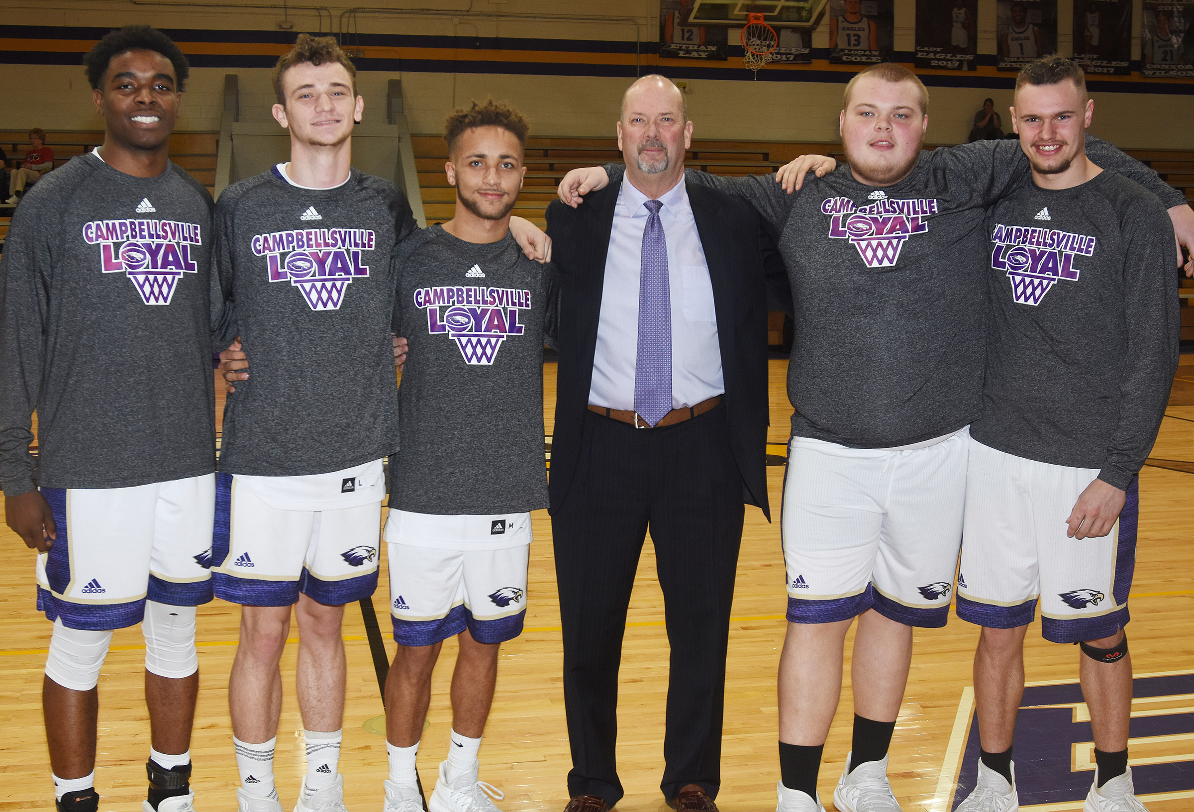 From left, CHS boys' basketball senior players Chanson Atkinson, Connor Wilson, Ethan Lay, Toyse Cox and Logan Cole are pictured with head coach Tim Davis as they are honored for their dedication to their team.