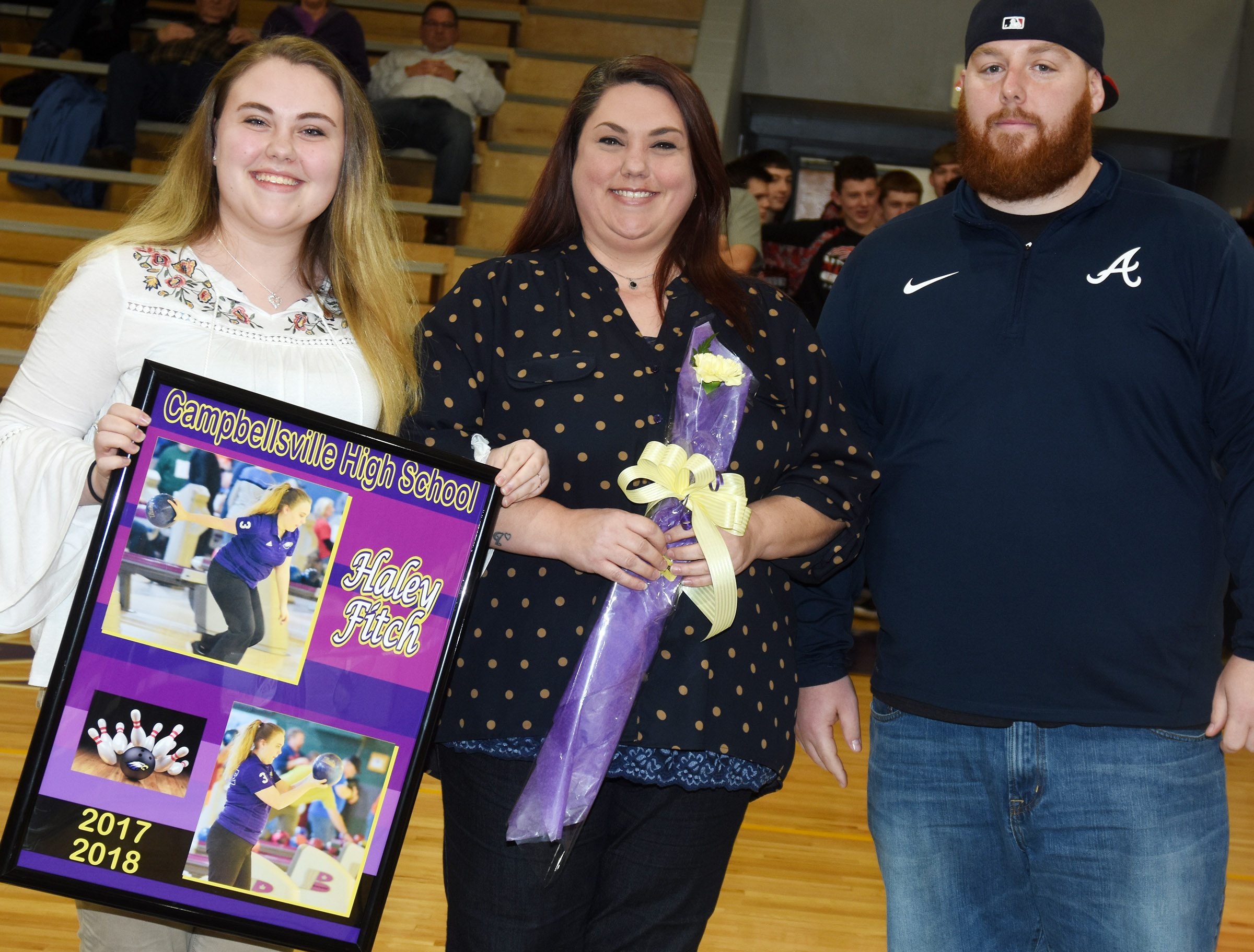 CHS senior bowling team member Haley Fitch is honored. She is pictured with her mother Abby Bowling and head coach Stephen Tucker.