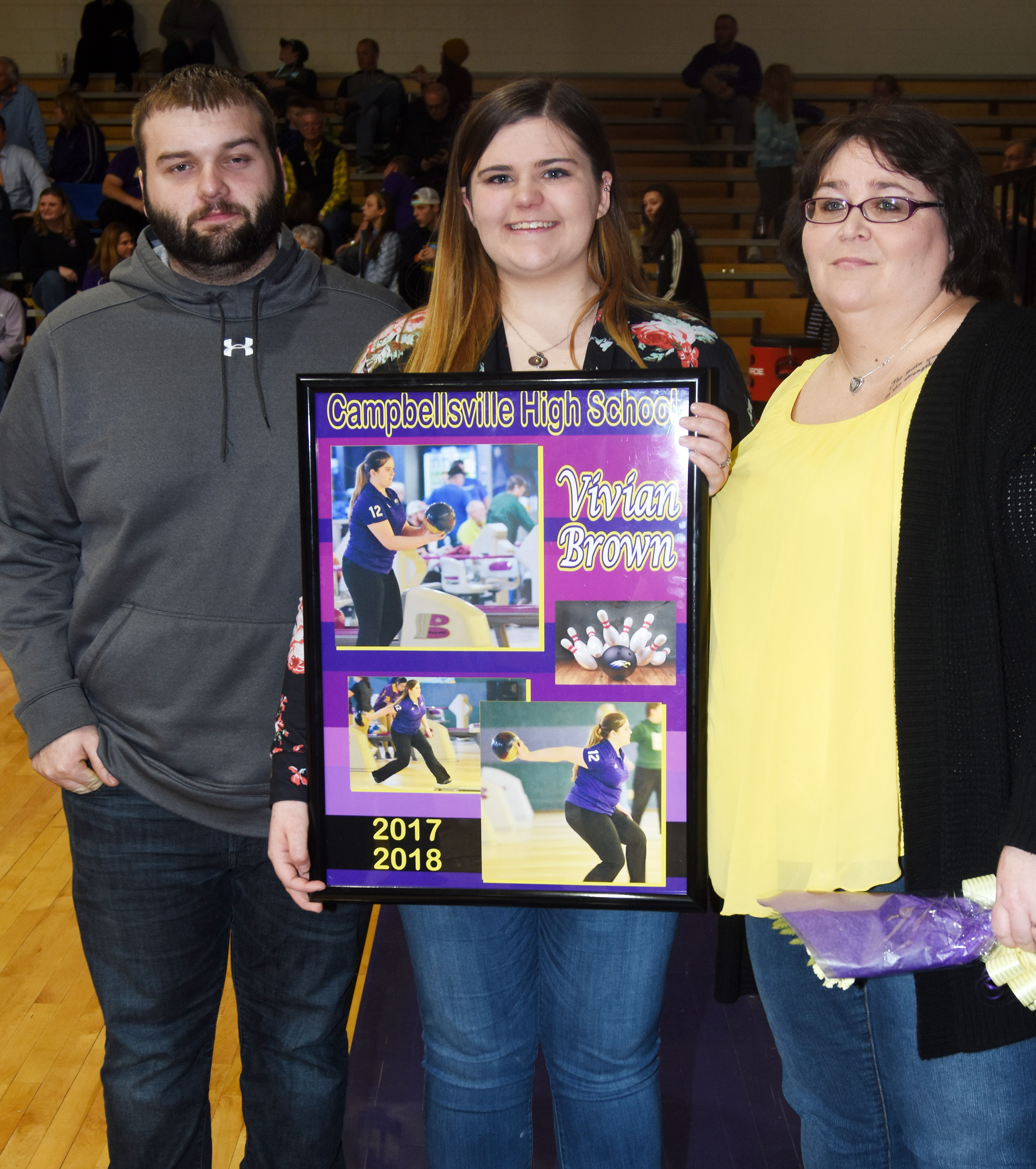 CHS senior bowling team member Vivian Brown is honored. She is pictured with her parents, Andrew and Tonya Tate.